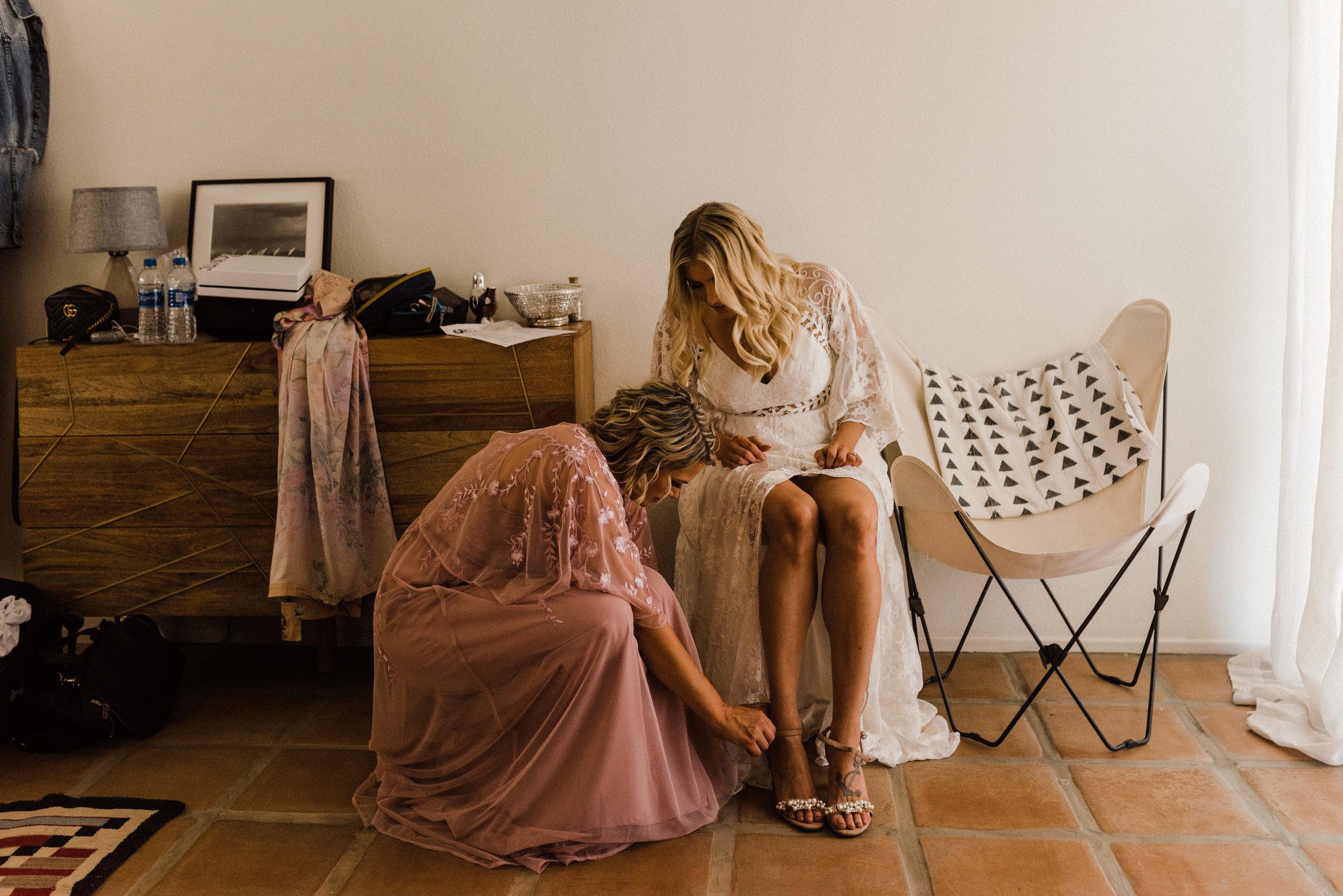 Bride getting ready at Cactus Moon Retreat in Joshua Tree California Intimate Wedding
