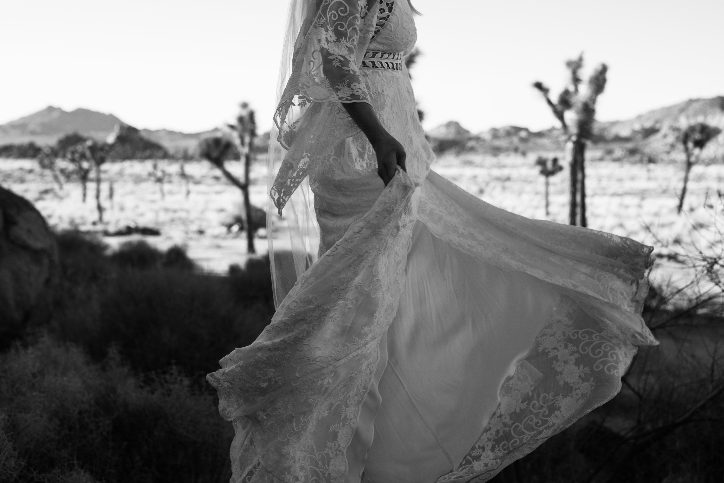 Bride in lacey boho rue de seine dress at Joshua Tree National Park