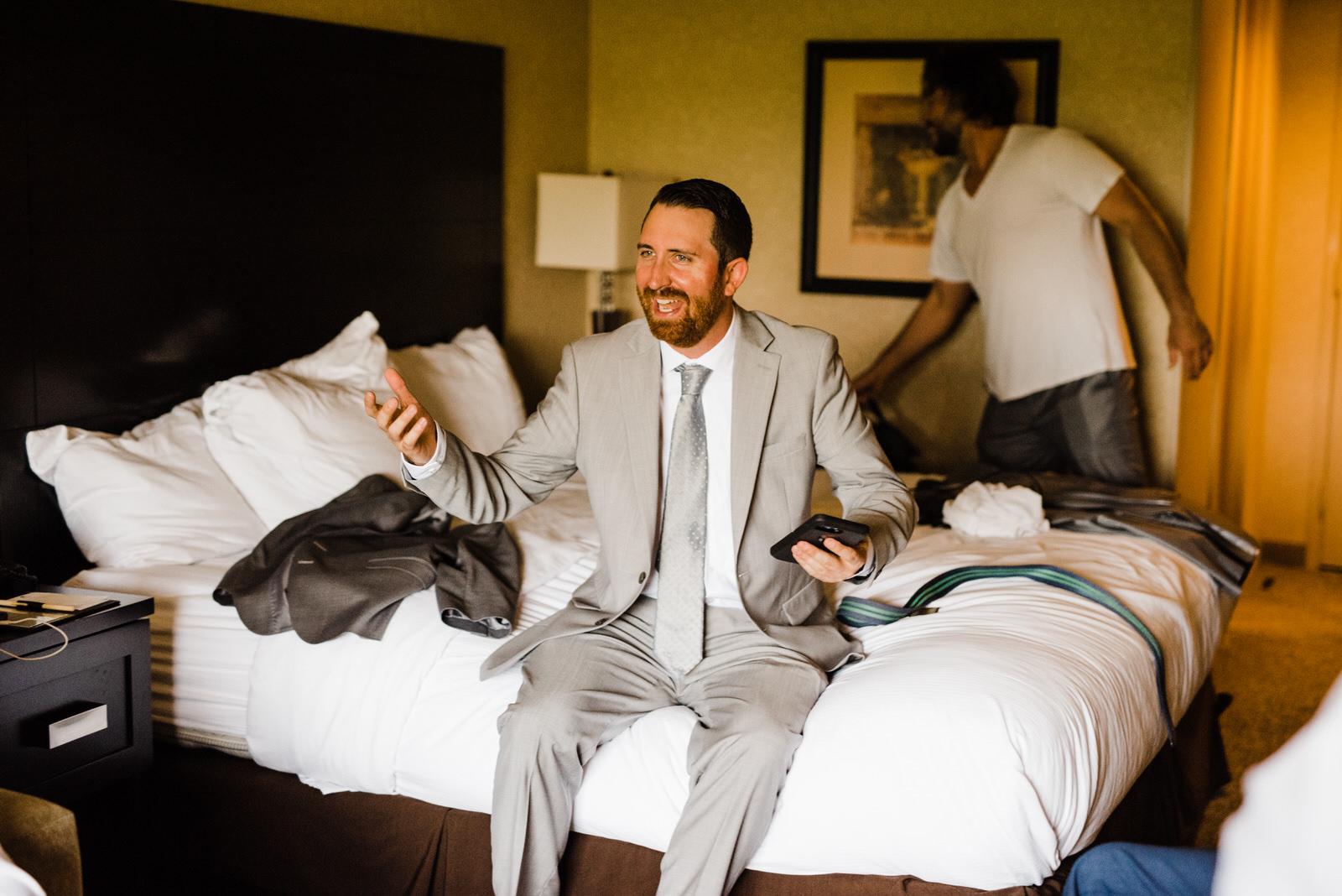 Groomsmen in hotel room getting ready | Roswell River Landing Wedding