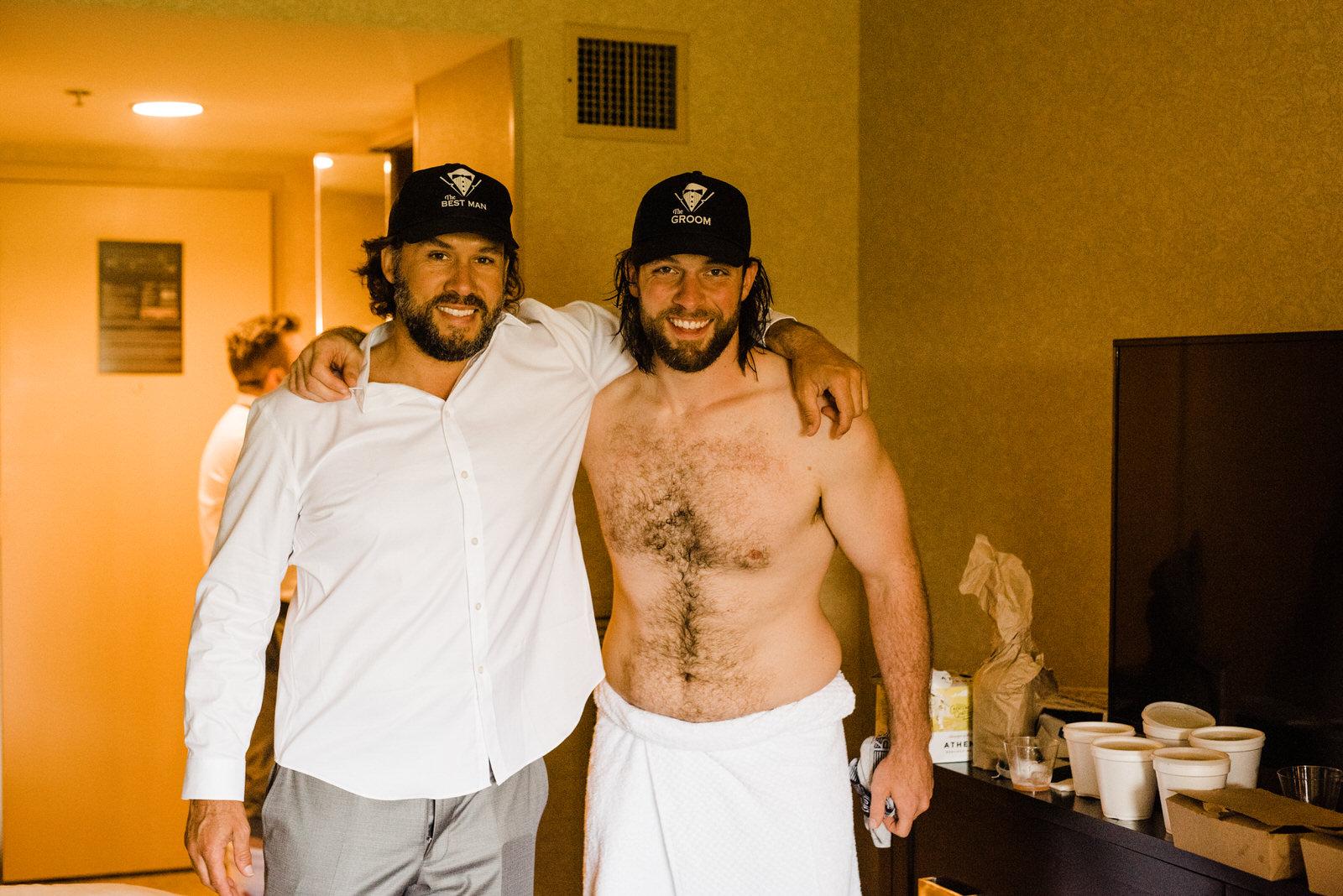 "Groom and brother wear custom ""Groom"" and ""Best Man"" baseball hats"