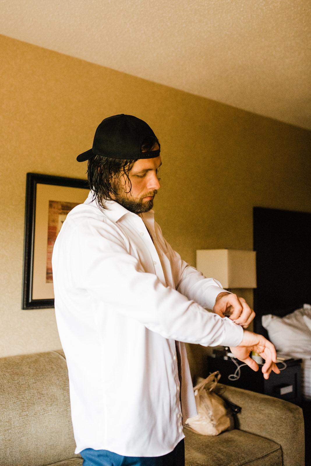 Groom getting ready in Roswell, Georgia before wedding