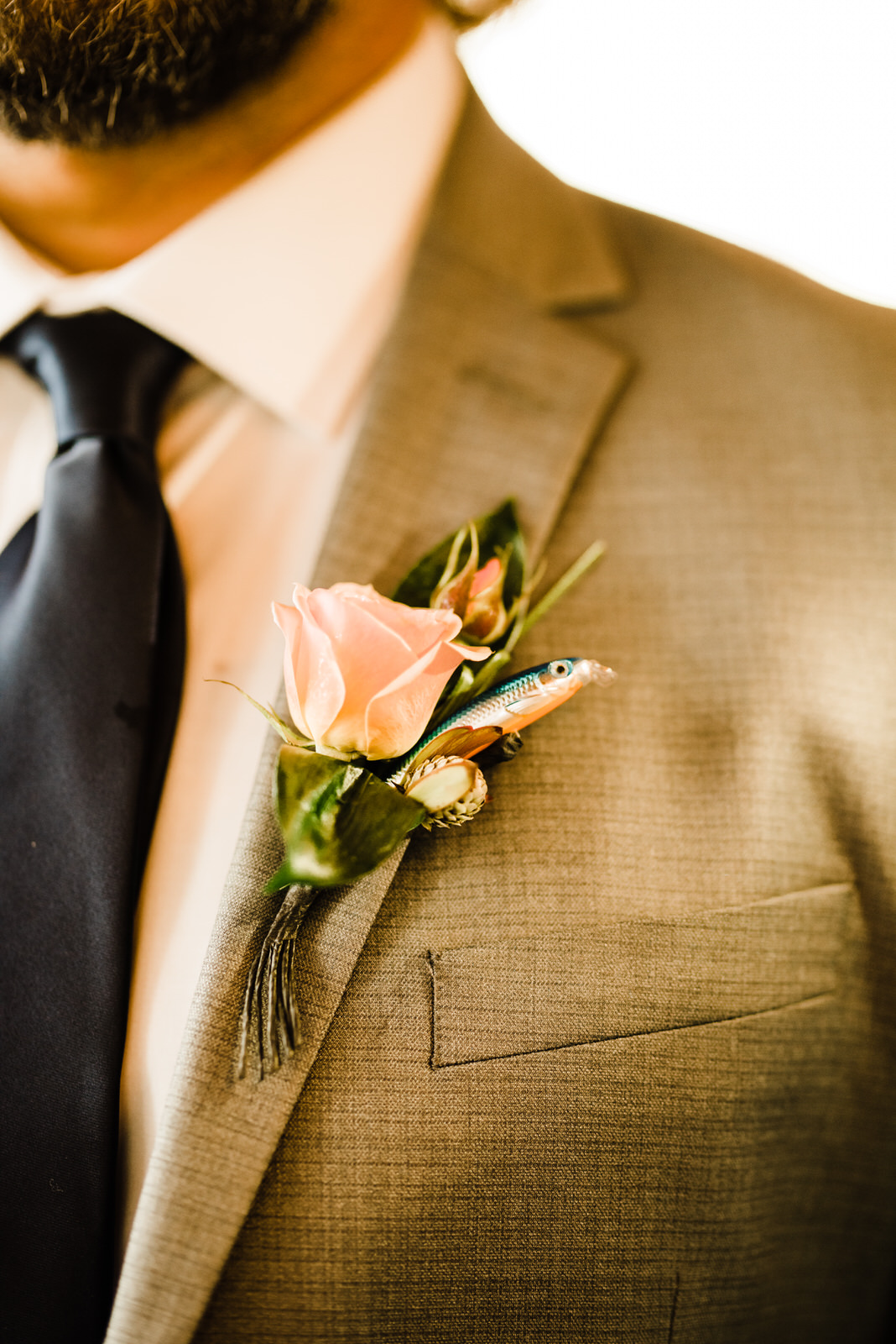 Unique boutonniere with fishin lure and rose
