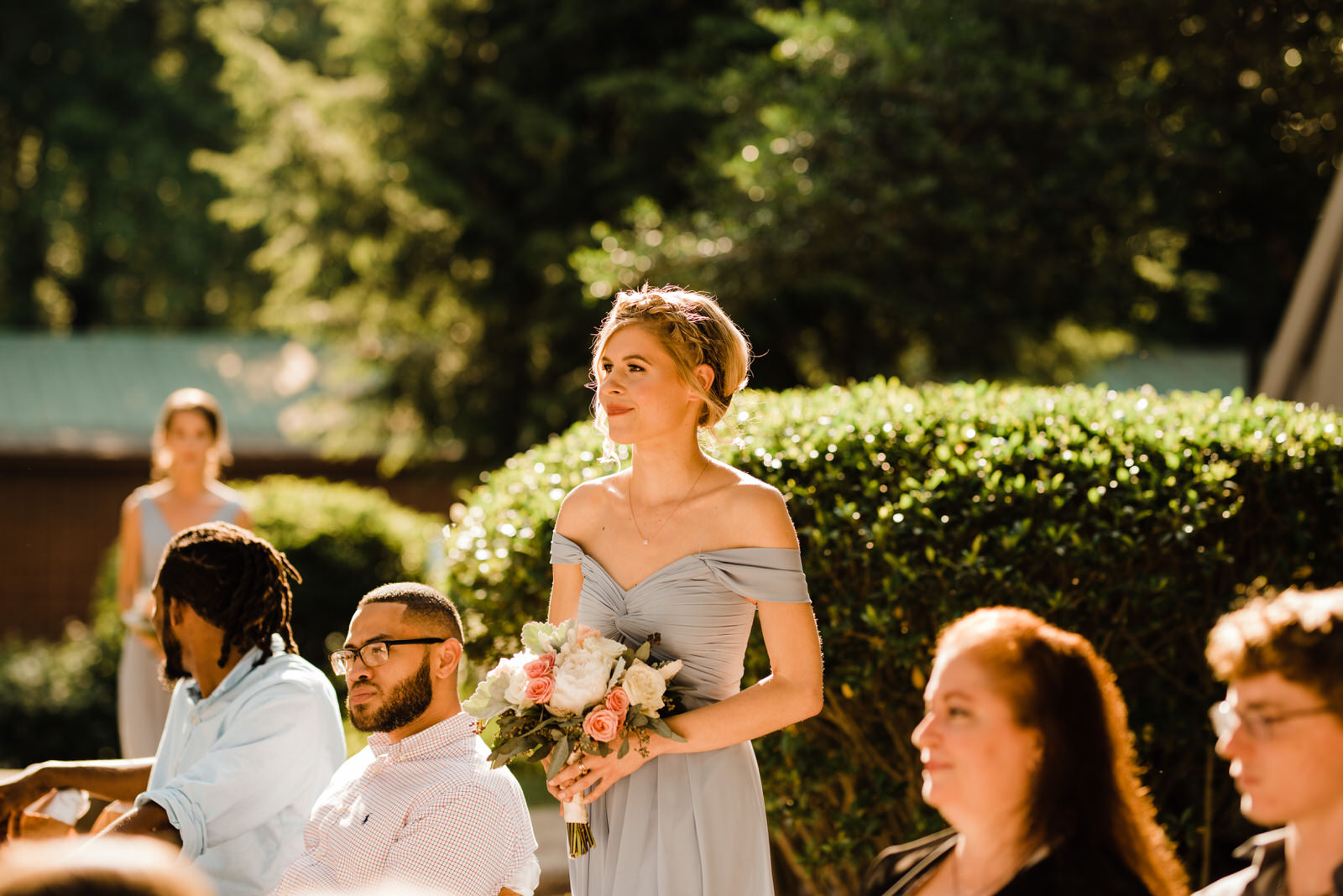 Bridesmaid in light blue off-the-shoulder dress at Roswell River Landing