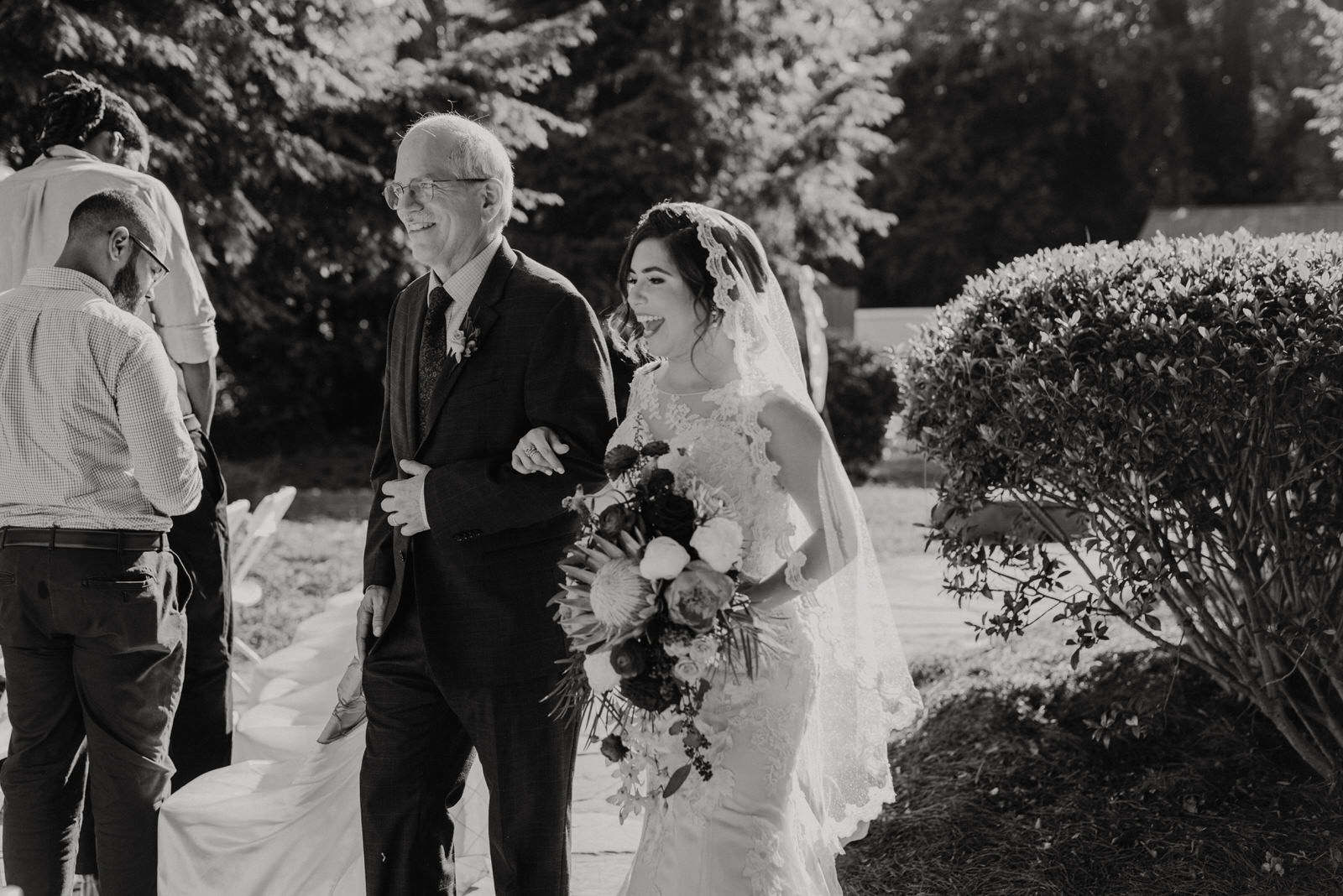 Bride and her Father walk down the aisle at Roswell River Landing