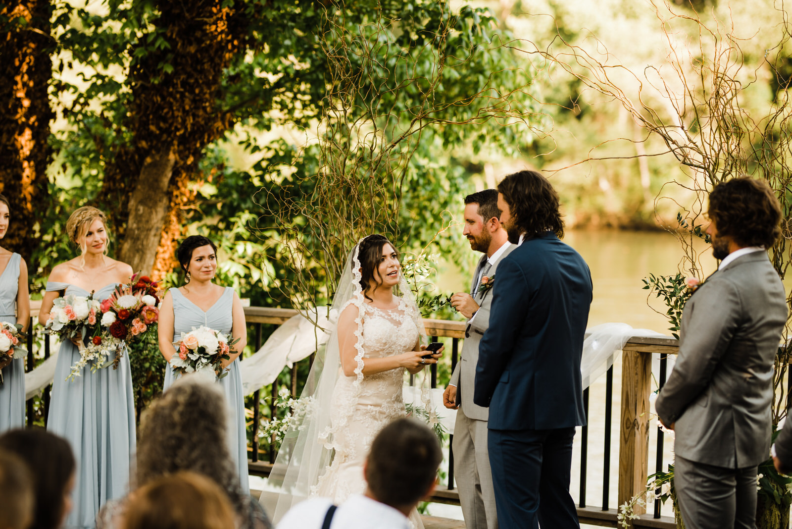 Bride reads vows at Roswell River Landing