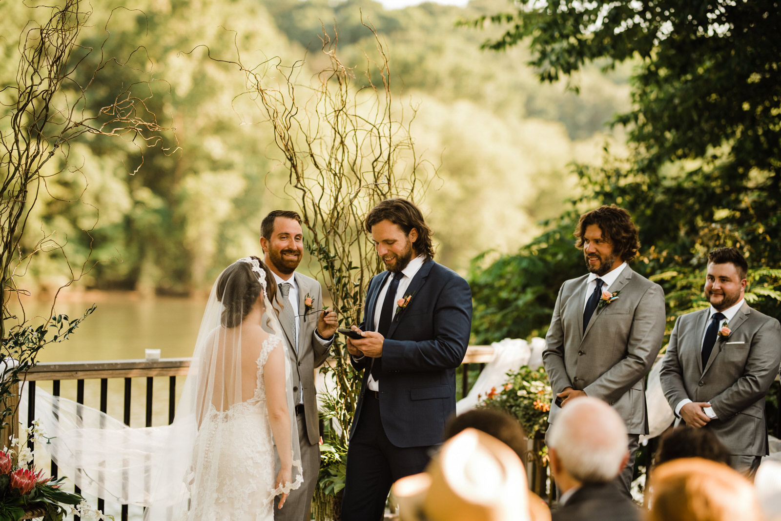 Groom reads vows at Roswell River Landing