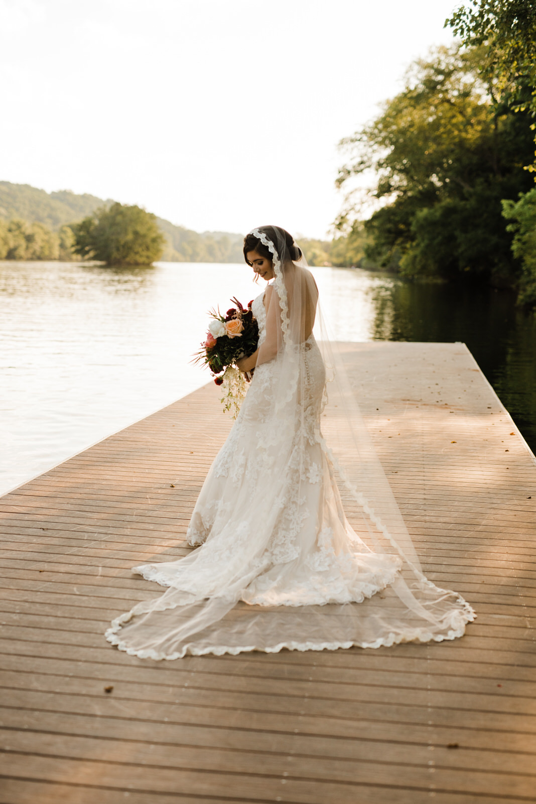 Bride with flowers wearing cathedral veil