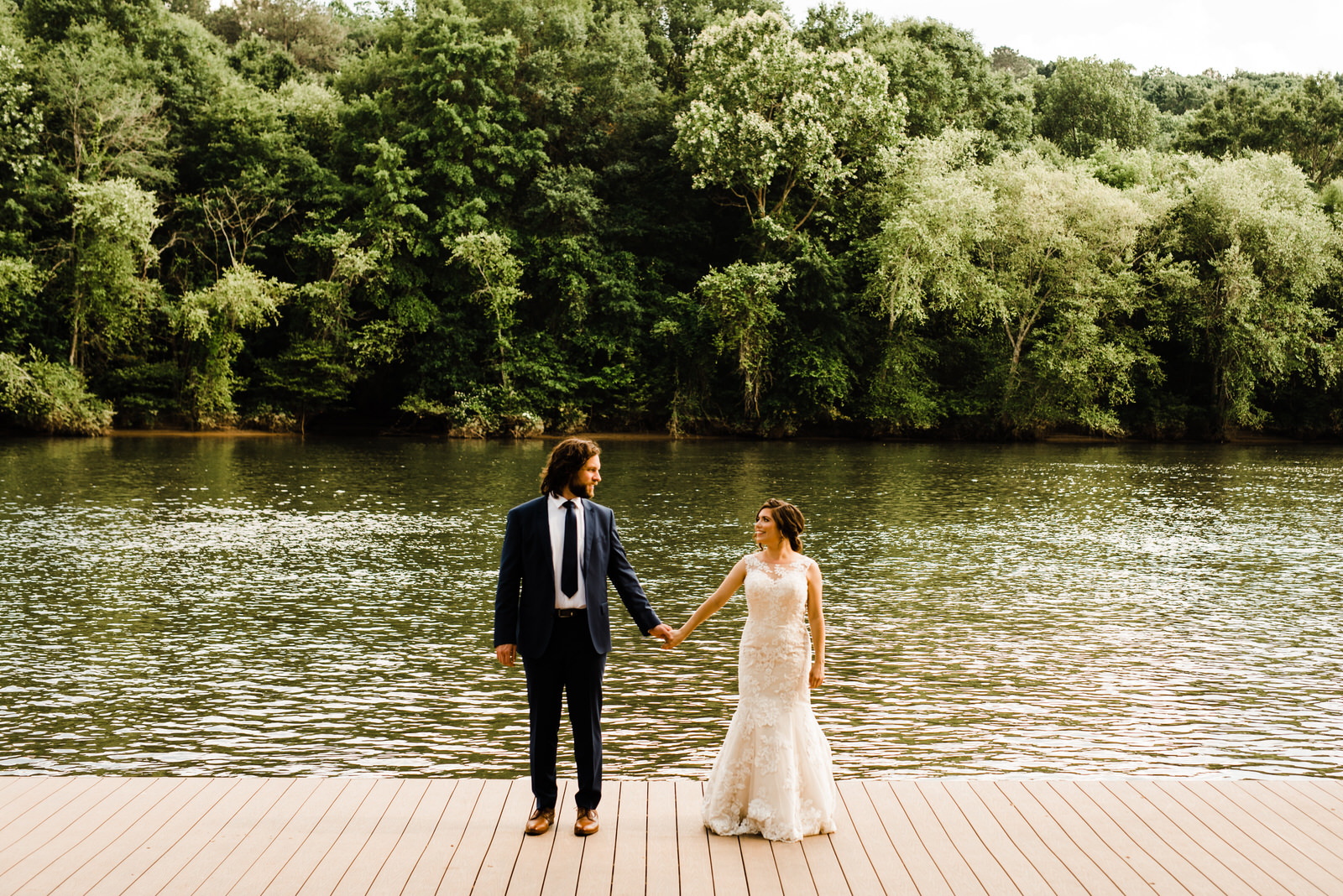 Bride and Groom at Roswell River Landing Dock in front of the Chattahoochee River in Roswell, Georgia