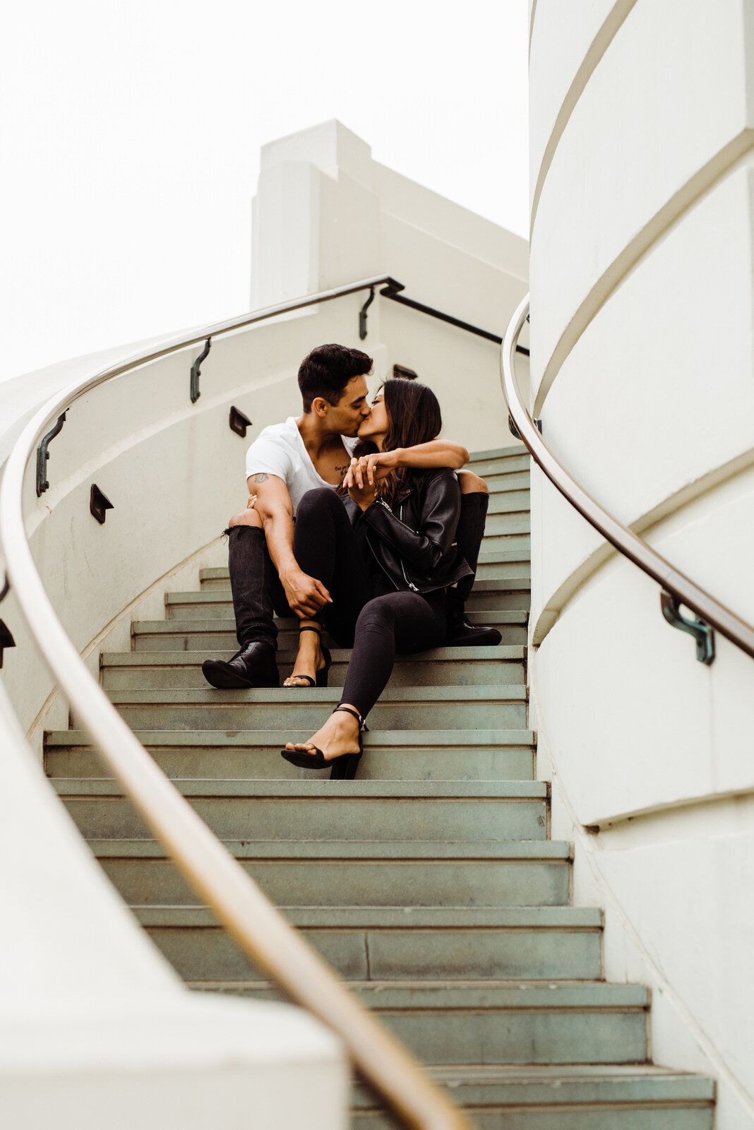 Couple Kiss on Griffith Observatory Staircase in Los Angeles, California