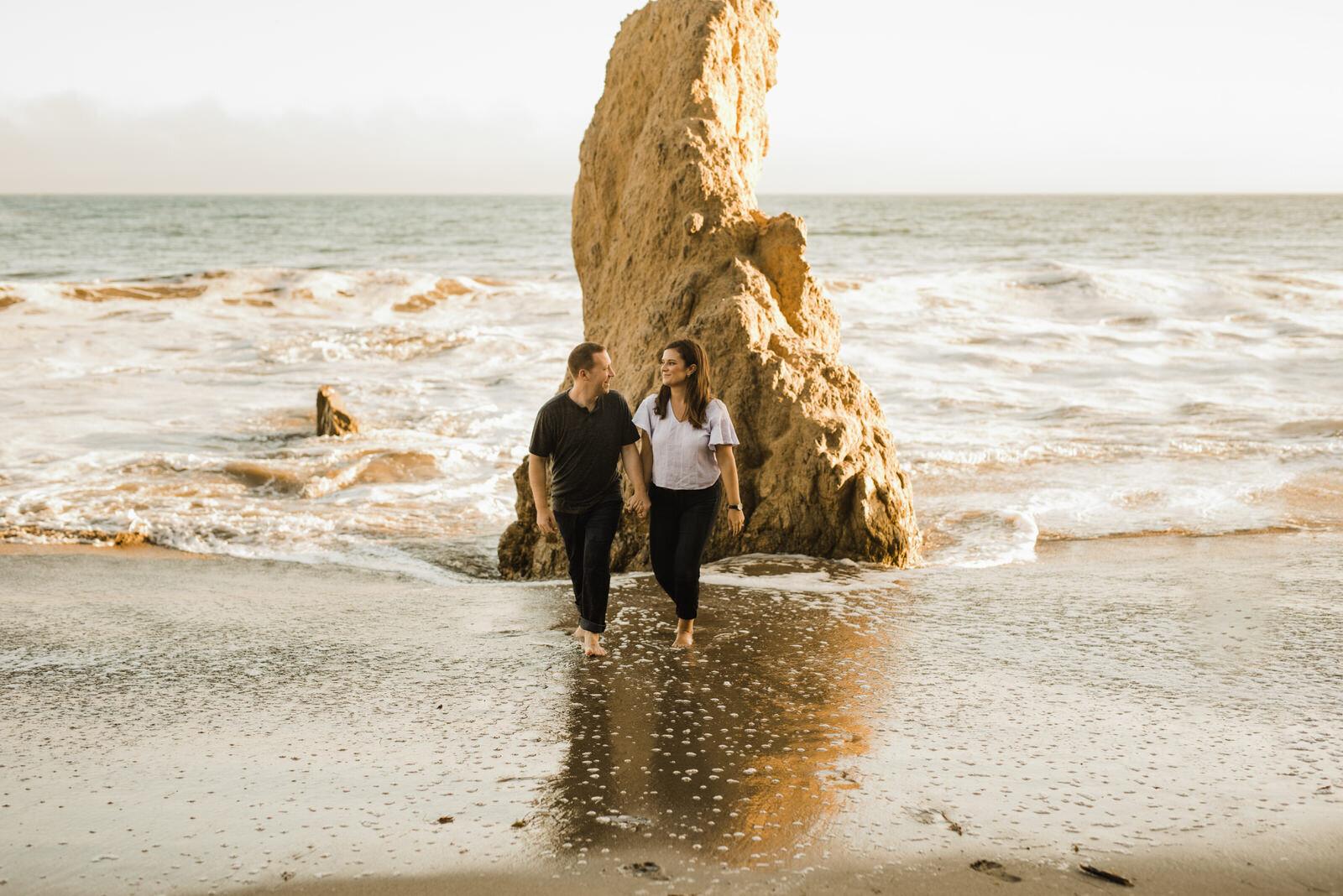 Playful, fun, romantic engagement photos at El Matador Beach