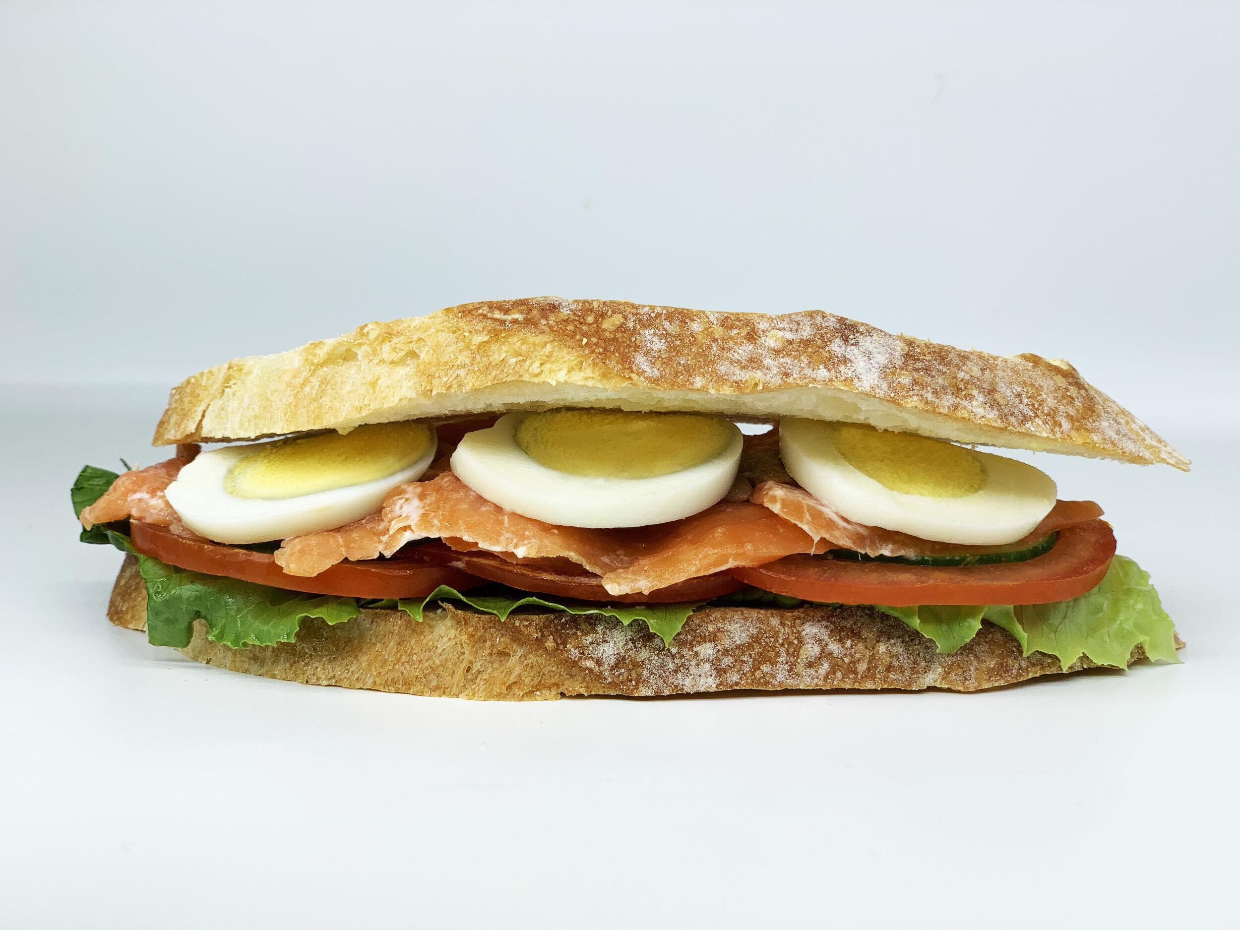 SMOKED SALMON SOURDOUGH - 416.35 KCAL PER SERVINGSmoked Salmon, Tomato, Cucumber, Egg, Butter Lettuce,12 Noon Caesar Dressing, Sourdough Bread$35