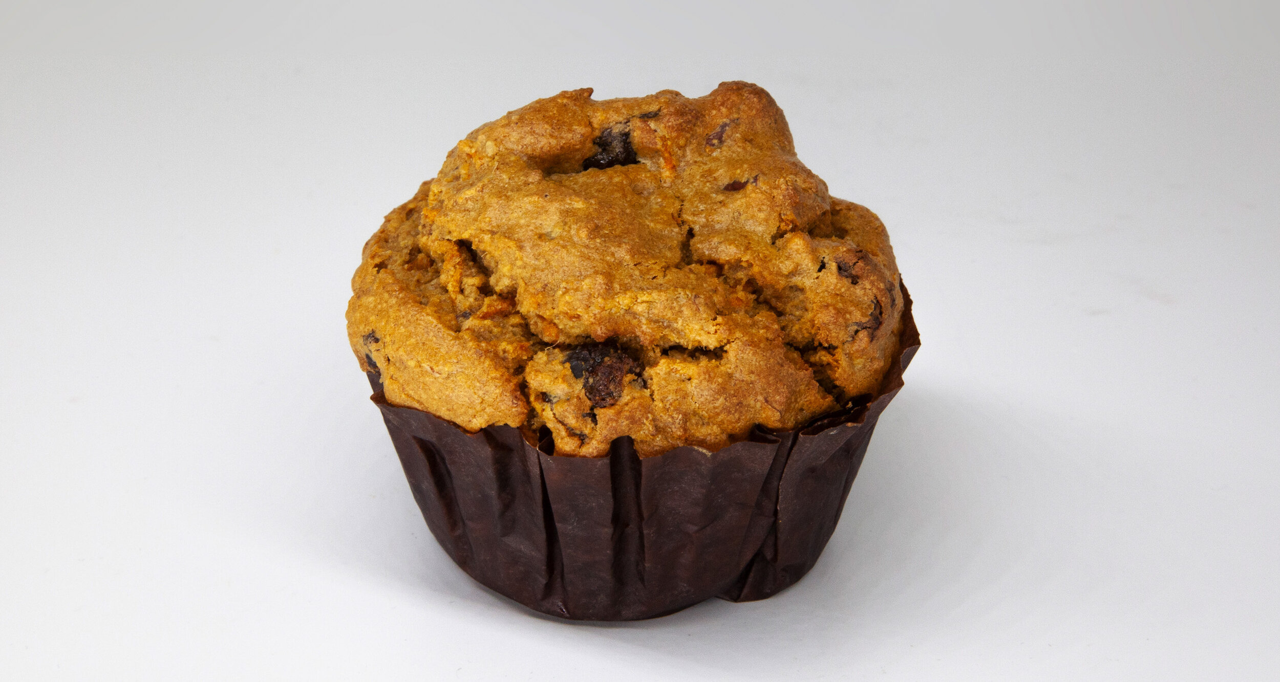 CARROT & NUT MUFFIN - 373 KCAL PER SERVINGOatmeal flour, apple sauce, brown sugar, vanilla extract, baking powder, baking soda, canola oil, salt, grounded ginger, carrots, eggs, raisins, almond$20