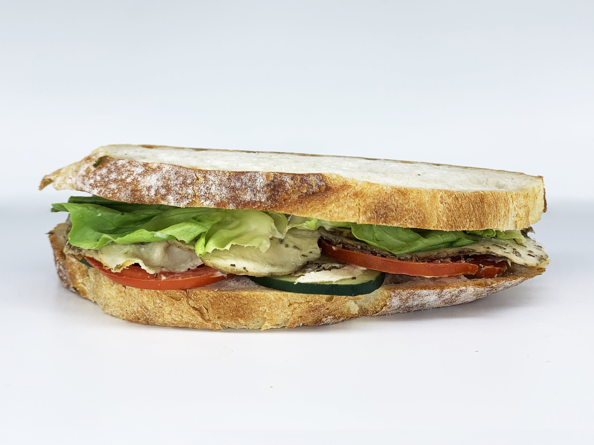 CHICKEN SOURDOUGH - 404.87 KCAL PER SERVINGChicken breast, tomato, cucumber, butter lettuce, 12 Noon caesar dressing, sourdough bread$32