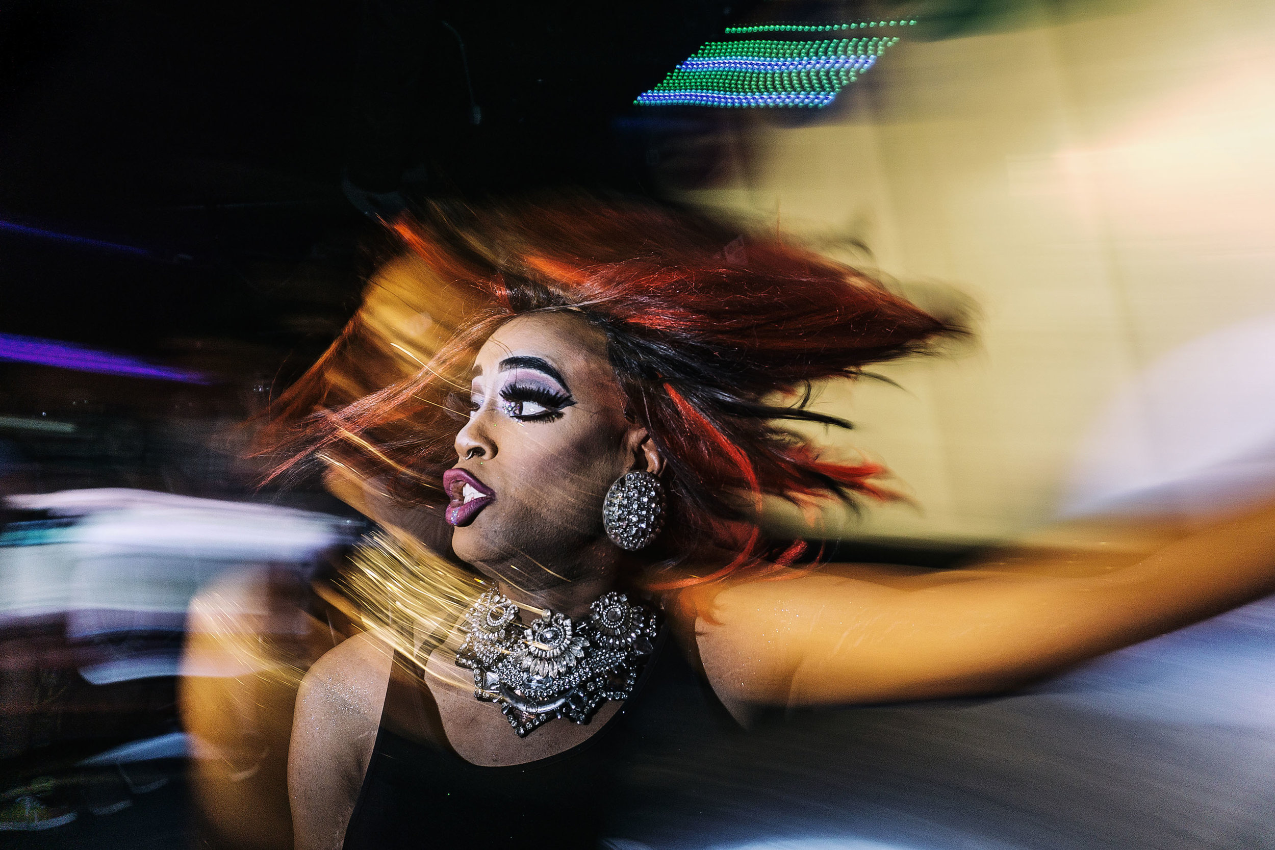 A drag queen performs during the Pride Week celebrations at Studio 13 in downtown Iowa City on Friday, Jun. 16, 2018.
