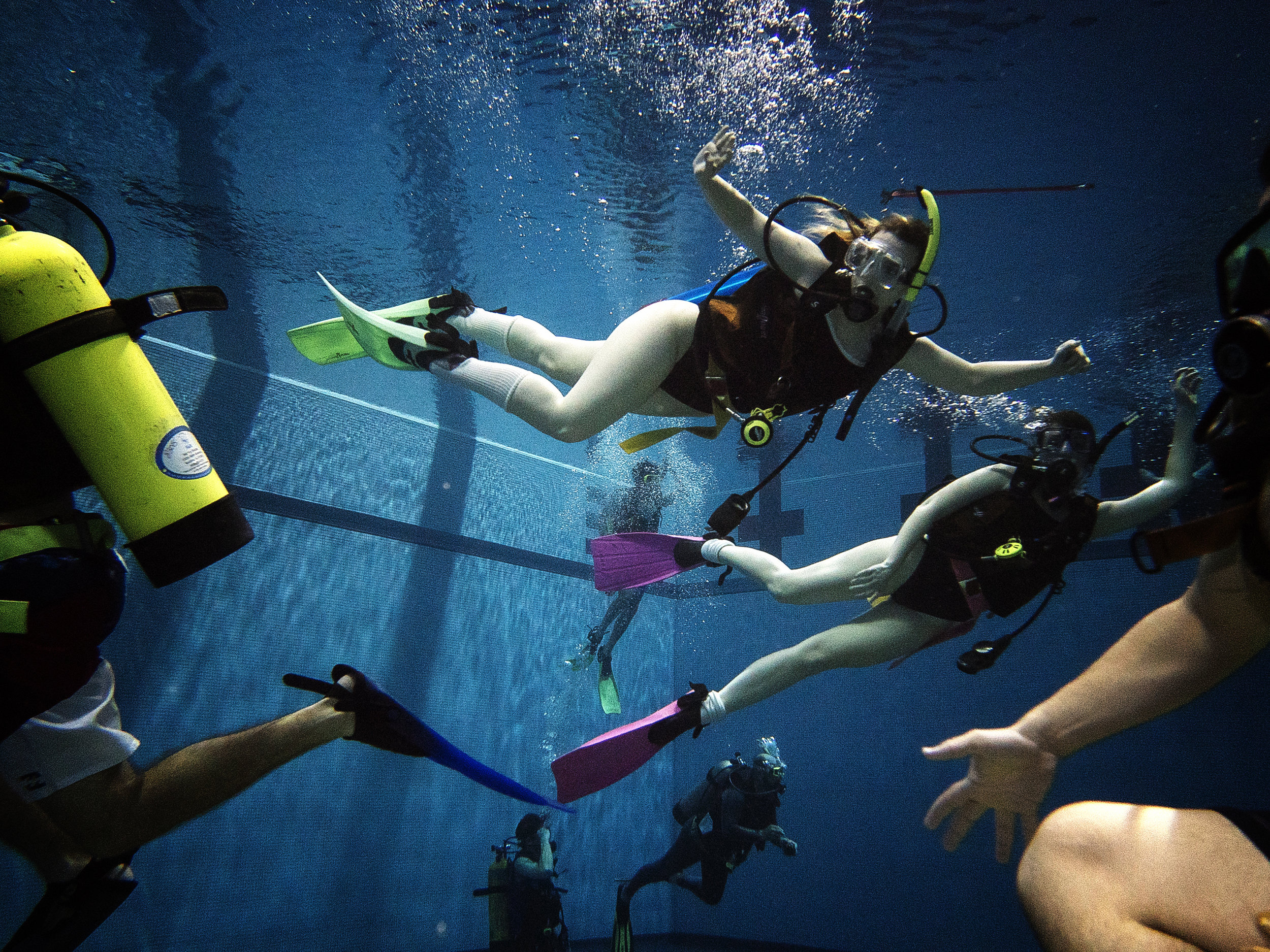 Students enjoy a period of free swimming at the CRWC in Iowa City on Tuesday, April 24, 2018. This was one of the class' last practice sessions before their open water certification at Lake Pearl, Illinois this summer. (James Year/The Daily Iowan)