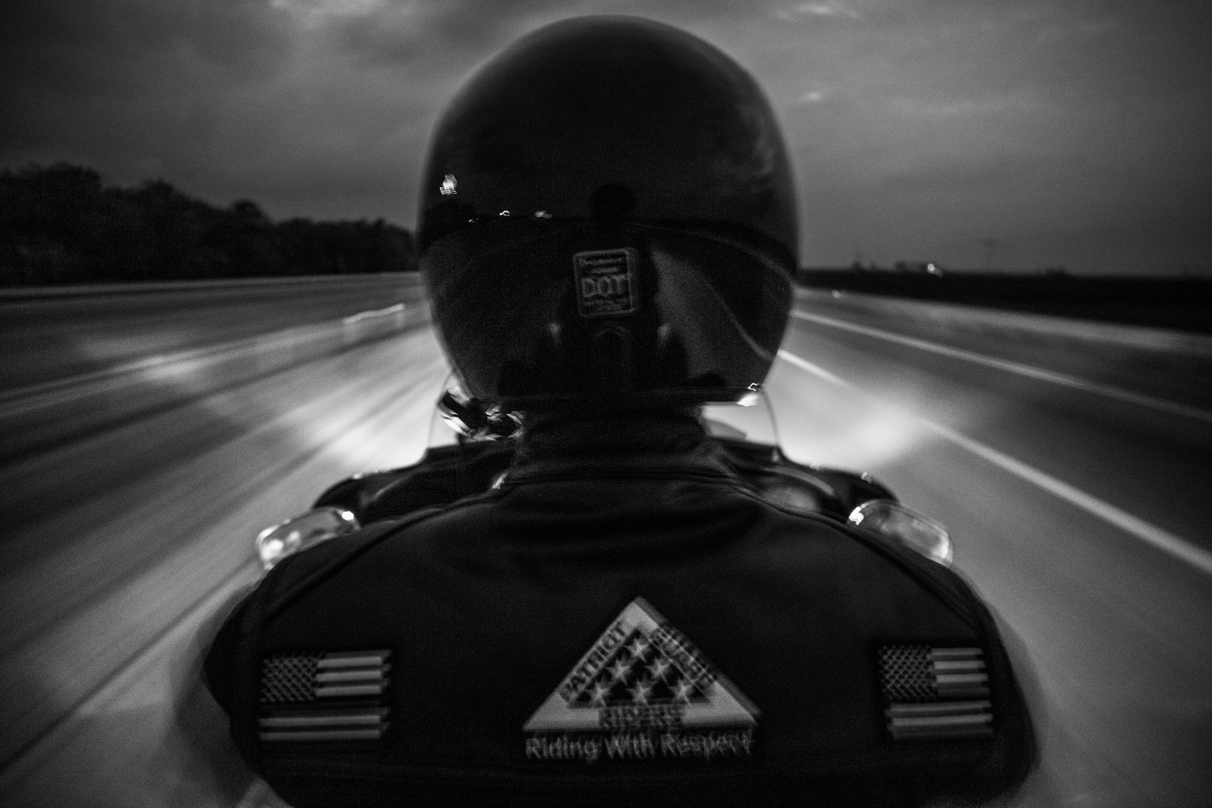 Patriot Guard Rider, Chris Krause, 32, rides his Harley Davidson motorcycle on Interstate 70 from Kingdom City to Columbia, Missouri for the 58th Honor Flight on Tuesday, Jun. 18, 2019. This was Krause's first honor flight ride, which featured 256 motorcycles at this event.
