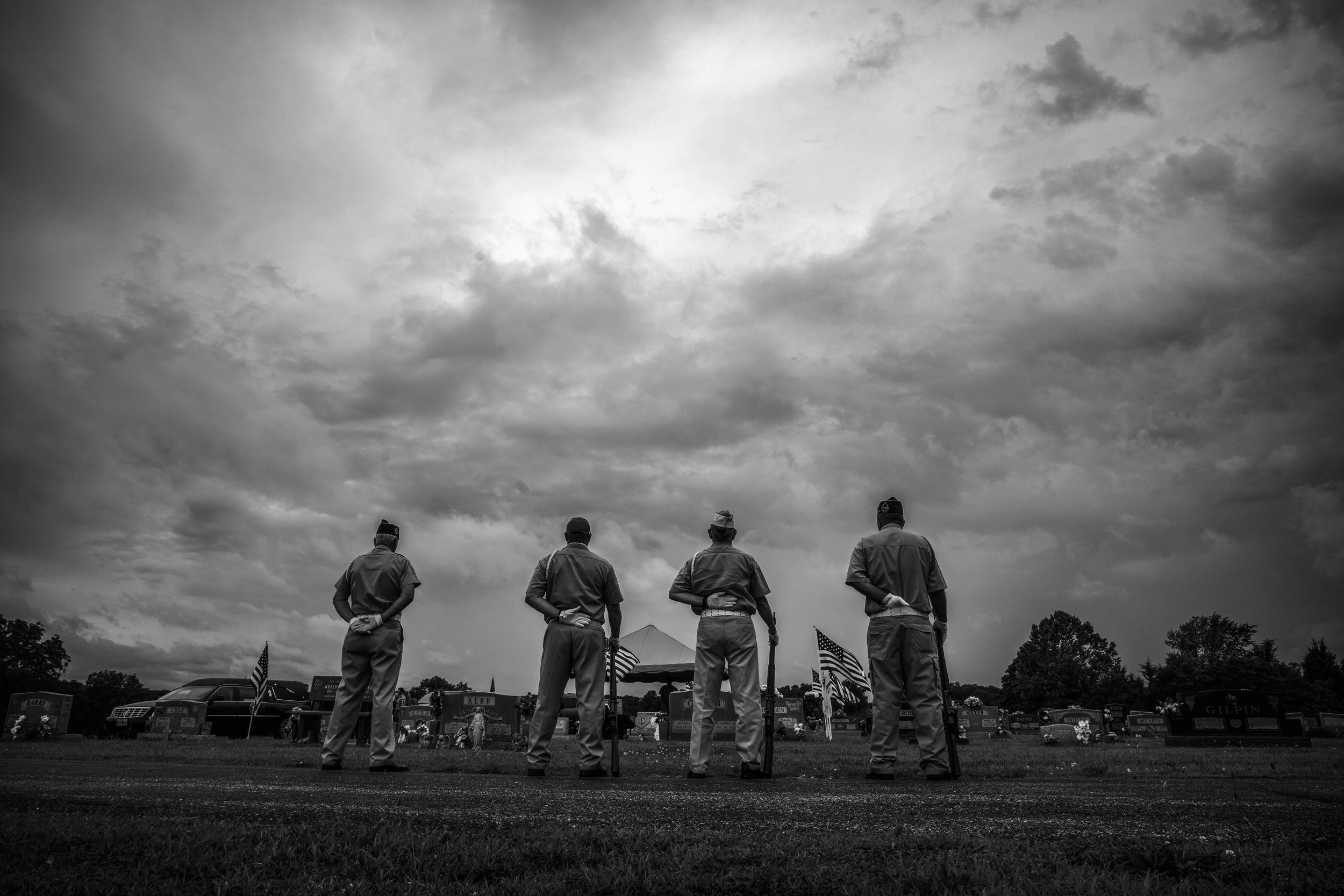 VFW 2442 Honor Guards wait before firing their 3 shot salute during a Vietnam veteran's funeral in central Missouri on Wednesday, Jun. 19, 2019.