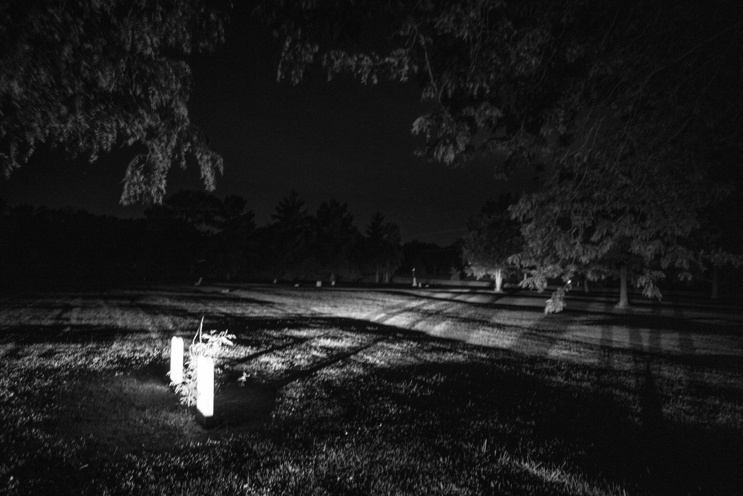 Gravestones as seen at night in Elmwood Cemetery in Mexico, Missouri on Thursday, Jun. 20, 2019.