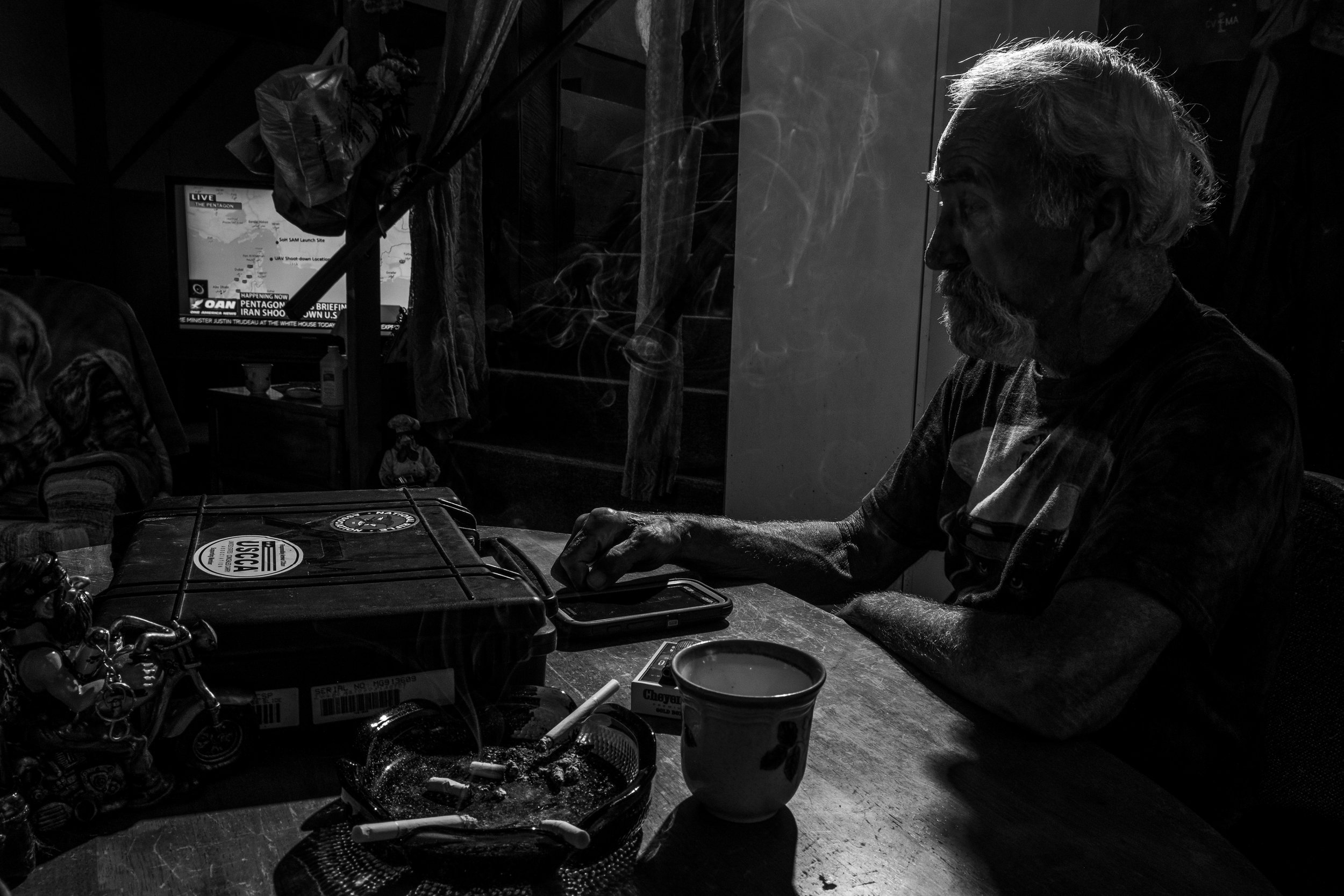 Marine Corp veteran and Patriot Guard Senior Ride Captain, Bill Walden, smokes a cigarette in his home on Thursday, Jun. 20, 2019. Walden served 12 years in the USMC in crash, fire, and rescue and served a tour at Khe Sanh in 1967 before being medically retired due to an accident in 1972.