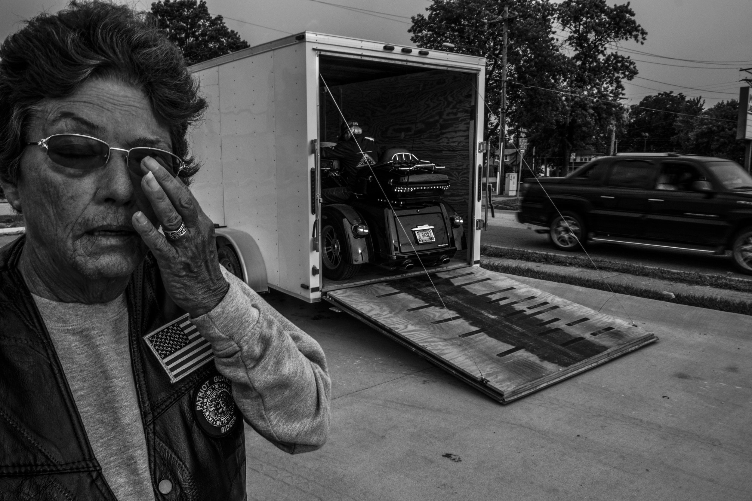 Patriot Guard Rider, Kay Walden, waits for her husband, Bill, to unload their motorcycle for an early morning ride around Mexico, Missouri on Friday, Jun. 21, 2019.