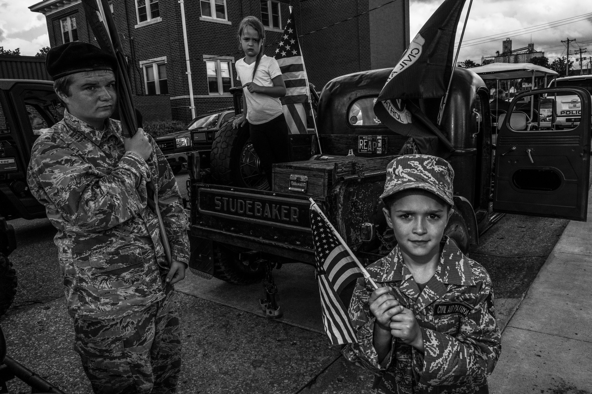 The Zumsteg kids pose for a portrait during the Real American Heroes parade in Mexico, Missouri on Wednesday, Jun. 2019.