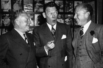 Comedian Fred Allen and colleagues with typical 50's suits