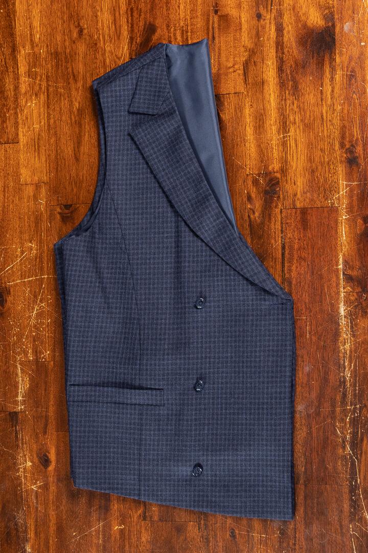 - Bespoke traveling double breasted waistcoat crease free navy shadow block plaid Dutch design