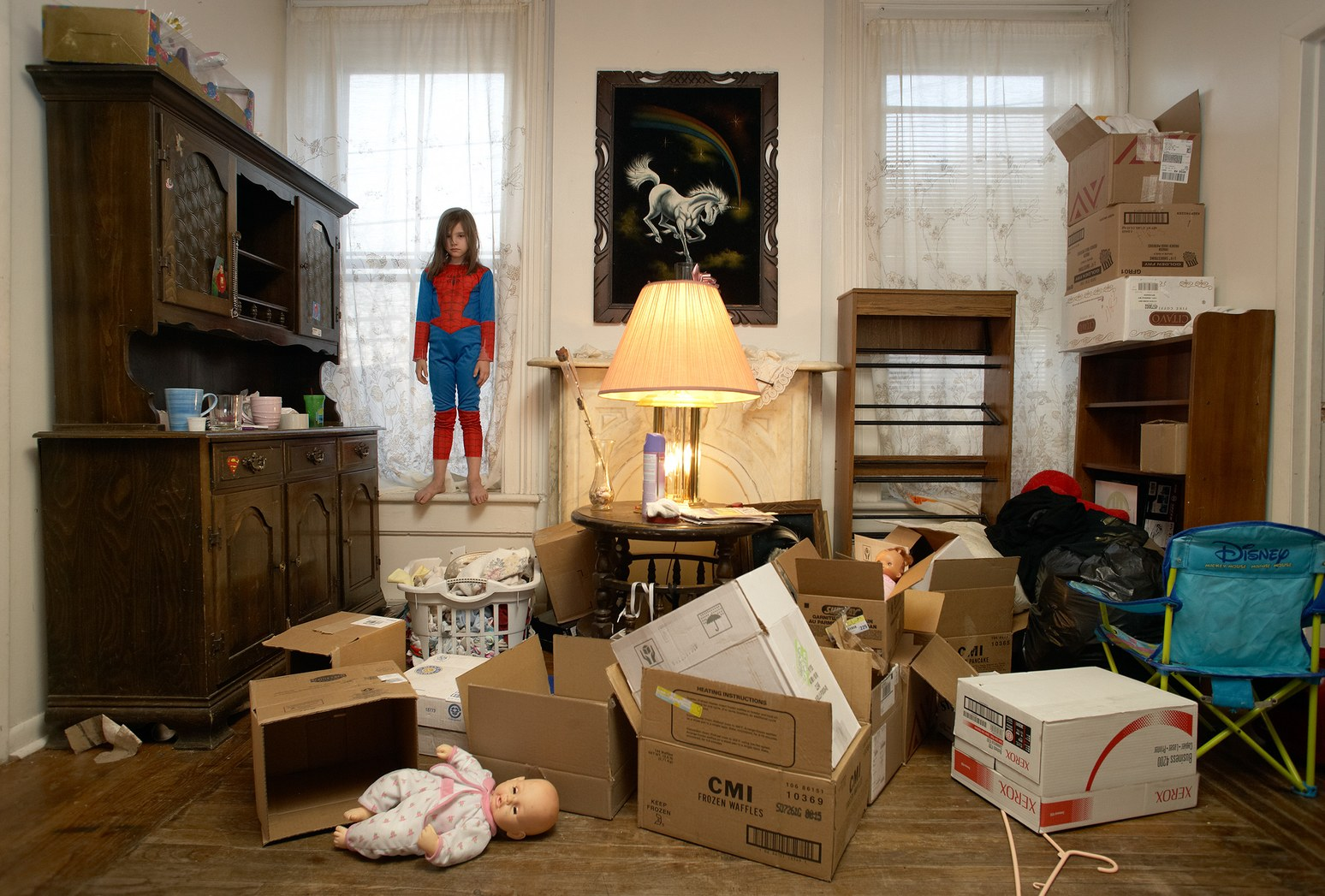 Laurie's daughter Katie found her Spider-Man costume among the boxes packed for the family's move from their last apartment in Troy. Photo- Brenda Ann Kenneally