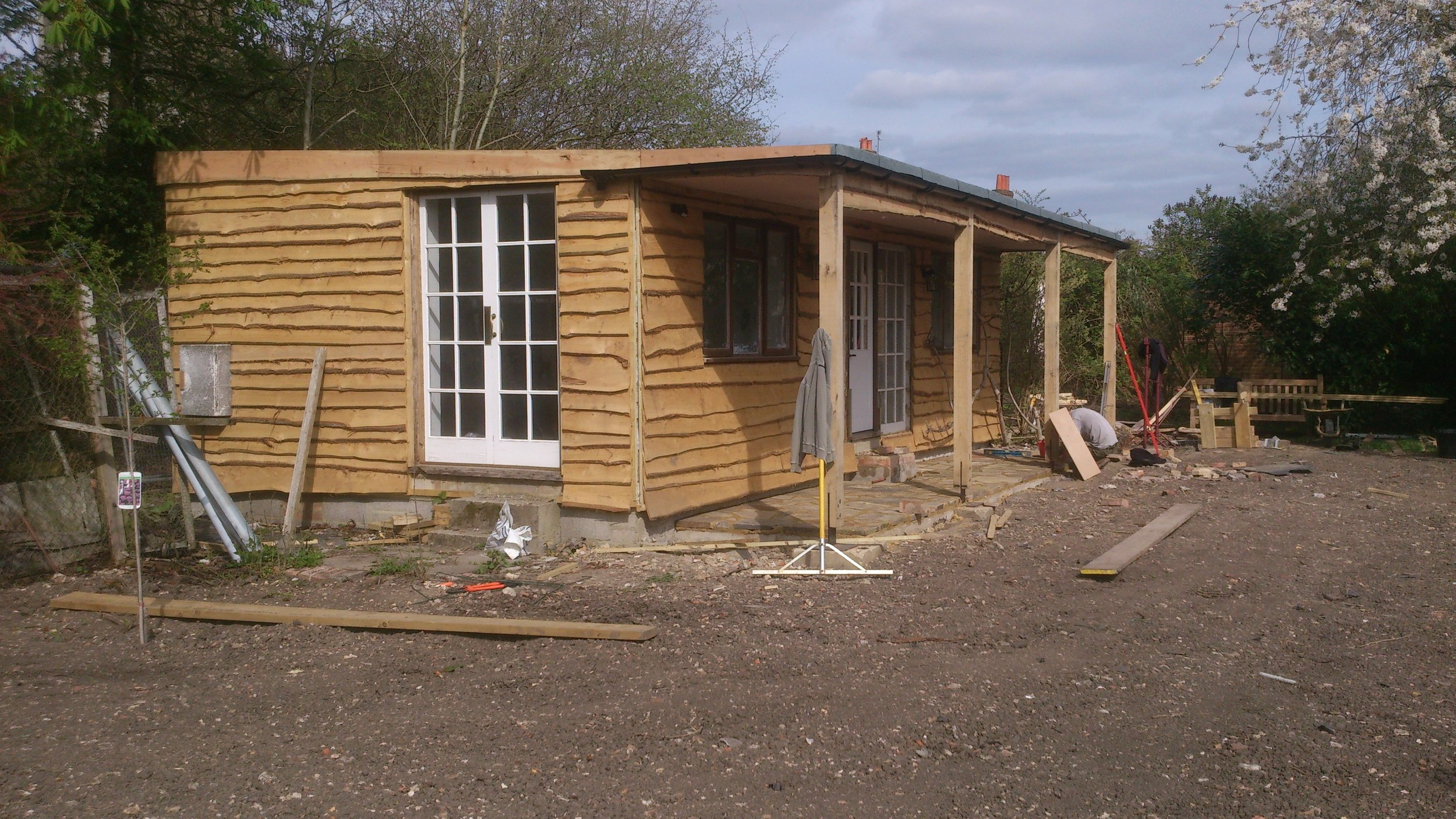 The renovated 'talking' shed with new porch and windows over looking the meadow.