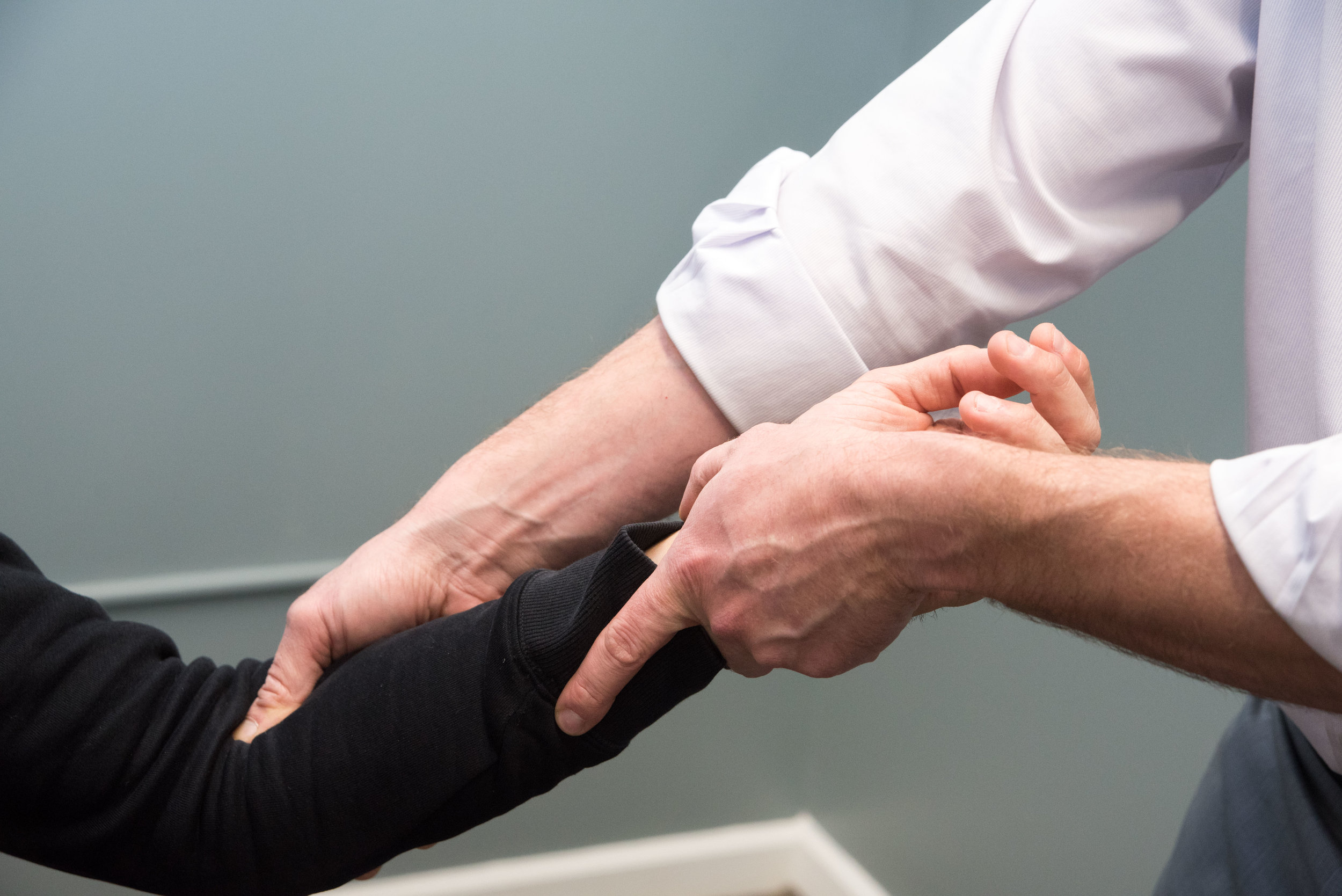 Chiropractic adjustment to the wrist.