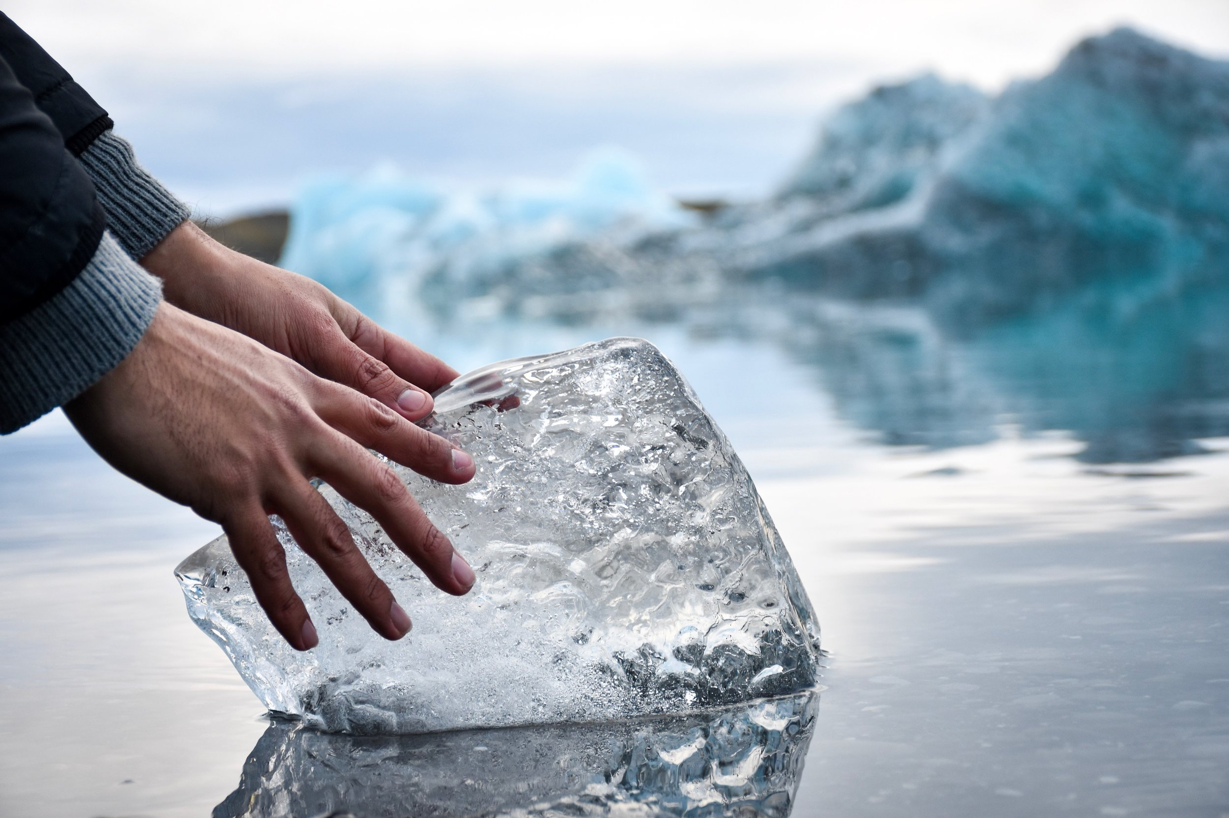 Hands on a block of ice