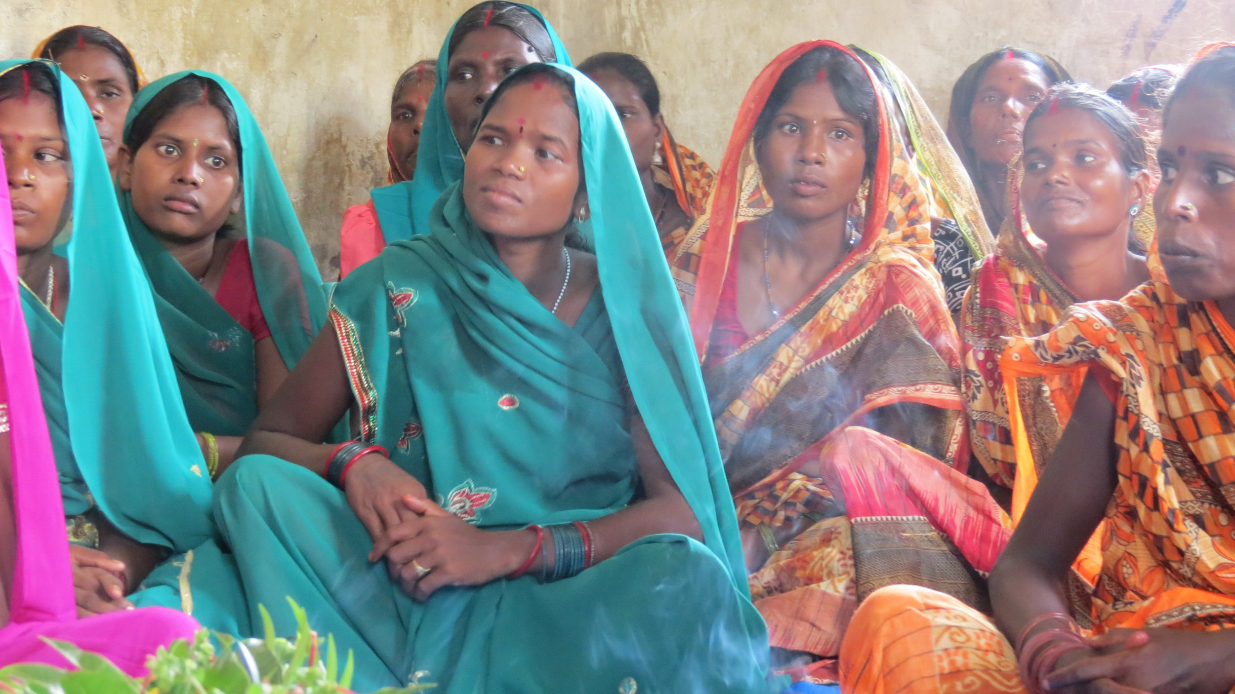 Gathering together to hear about the impact of Heifer International on these women, their families, and their community