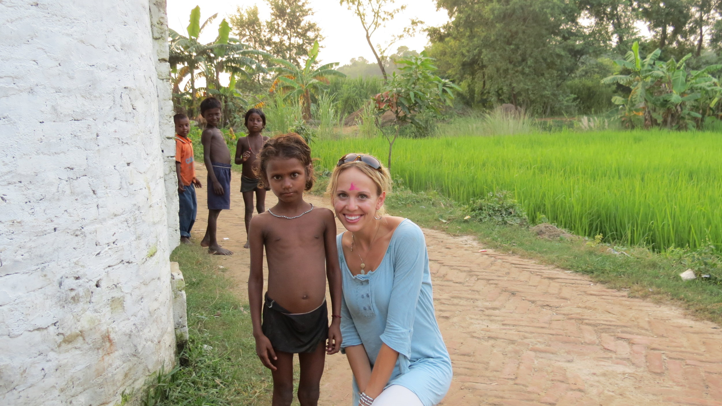 a picture with a local village child--the pink on my forehead was put there by the women of the community when we arrived