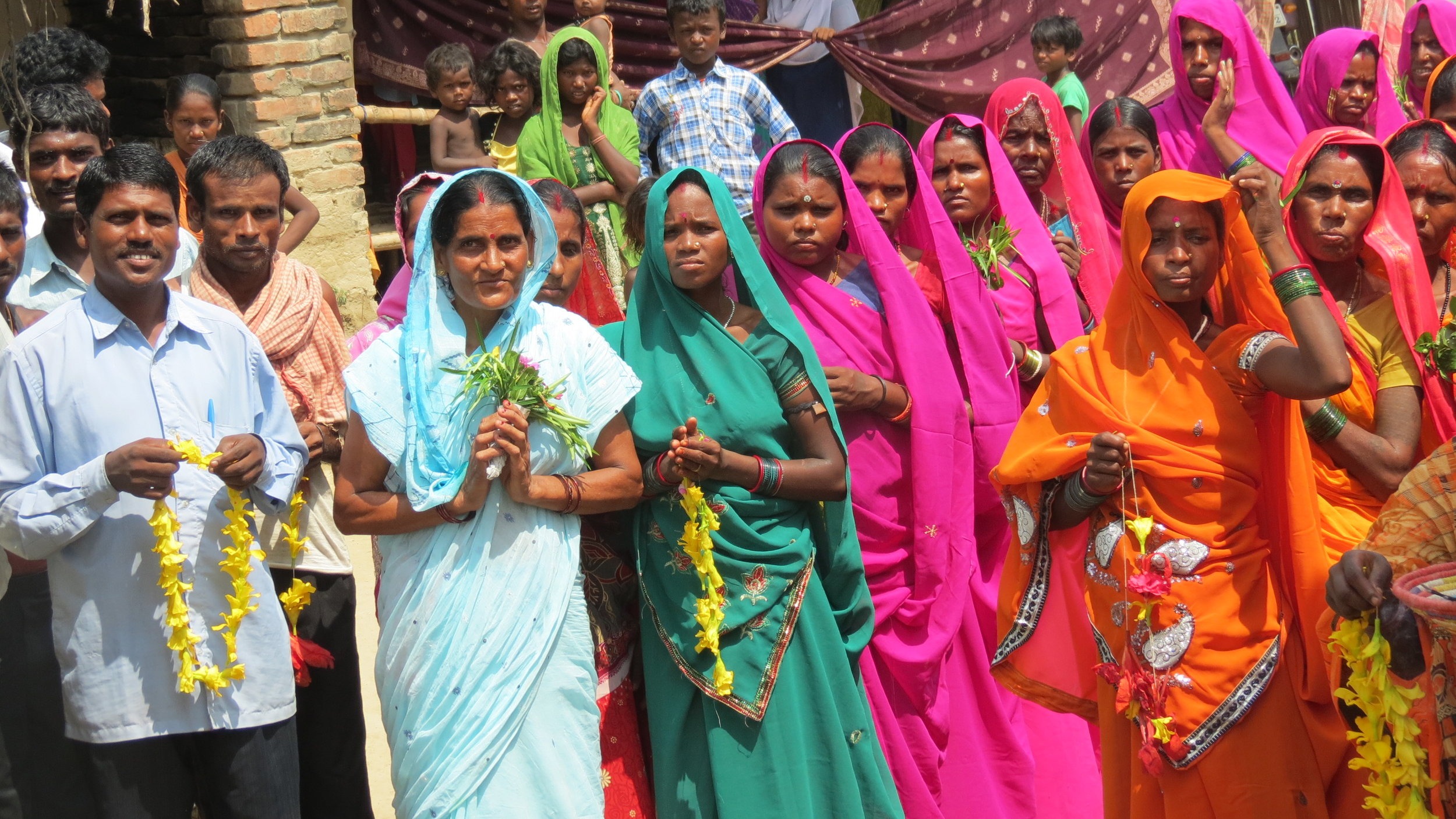 the people of a small community awaiting our arrival--with all sorts of flowers and gifts as tokens of their gratitude