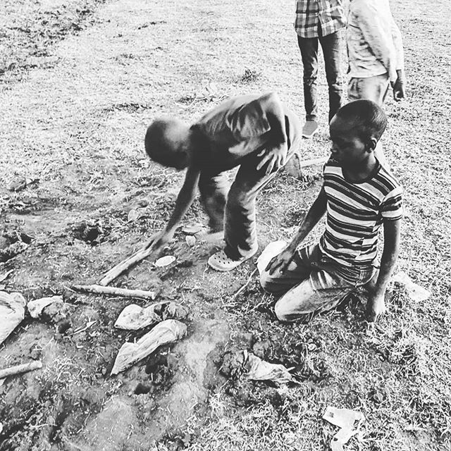 Kids digging in the ground to find termites for a snack #africa #africamissiontrip #africamissiontrip2019 #okafrica #termitesforlunch