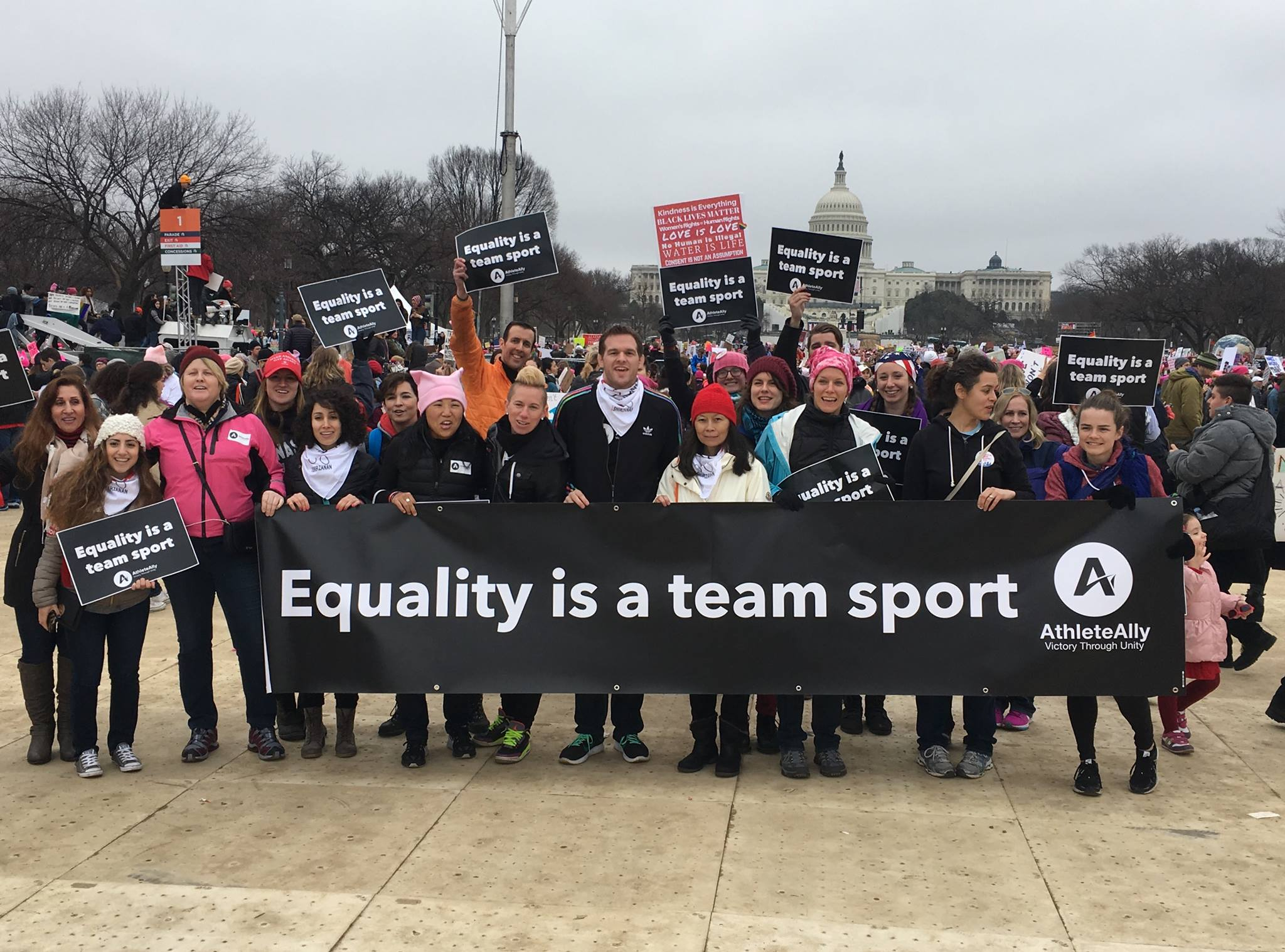 Athlete Ally with a banner in front of the U.S Capitol building.