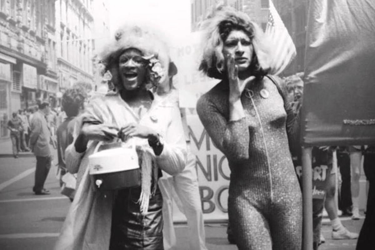 Marsha P. Johnson (left) and Sylvia Rivera (right) march in New York City in 1973. Photo courtesy of Netflix.