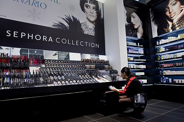 A full display of makeup products in Sephora's retail store.