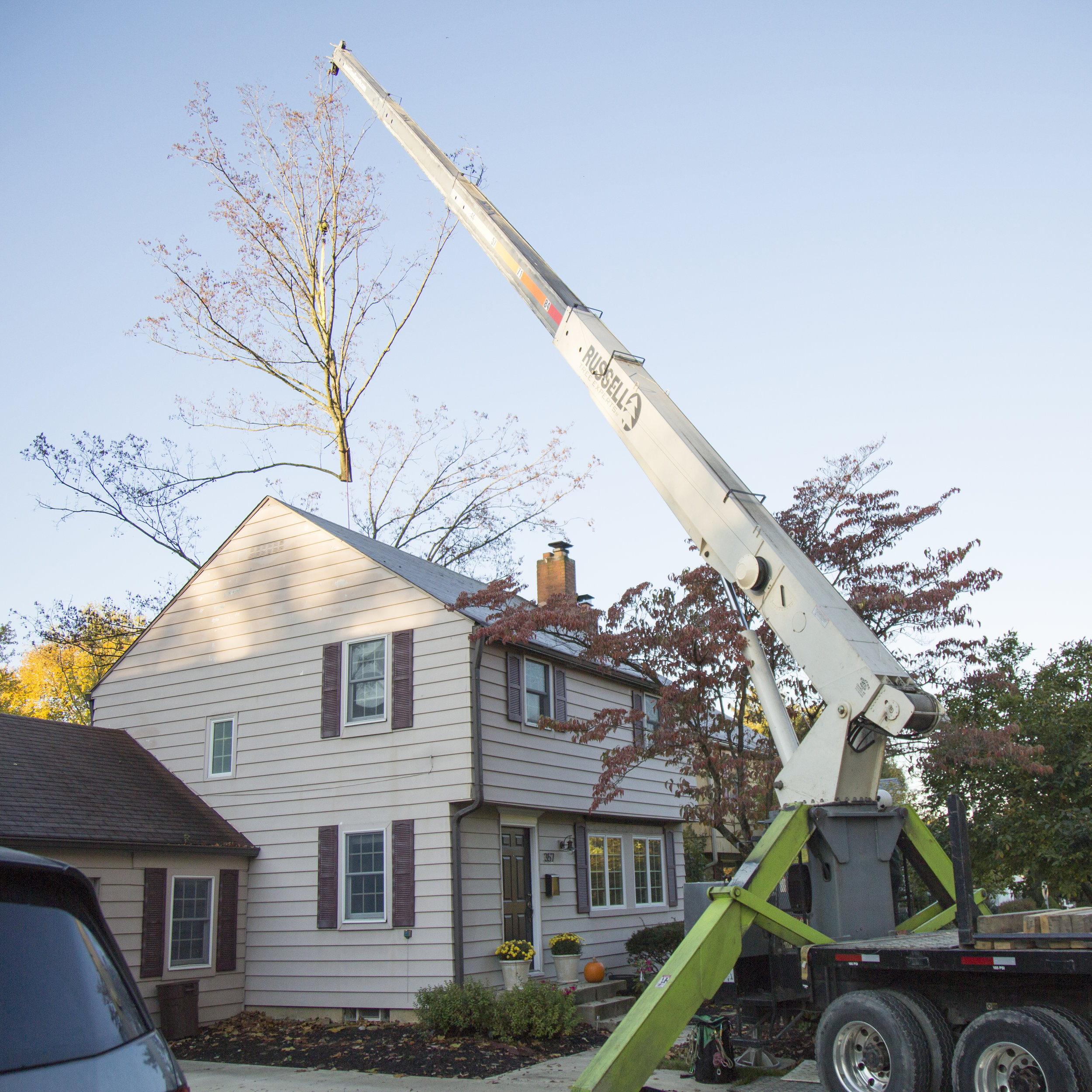 Cranes - When trees grow over sensitive pavement and structures, our company owned cranes and on staff licensed operators can rig and lift trees up and over obstacles, protecting the valuable property beneath.