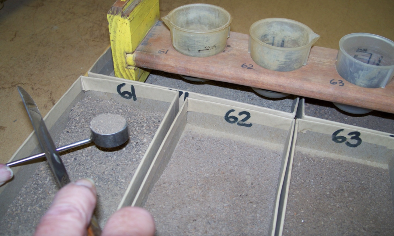 STEP 3 - A CLC LABS Technician uses a precision scooping technique on dried, crushed, and sieved soil and places the sample into an extraction cup.