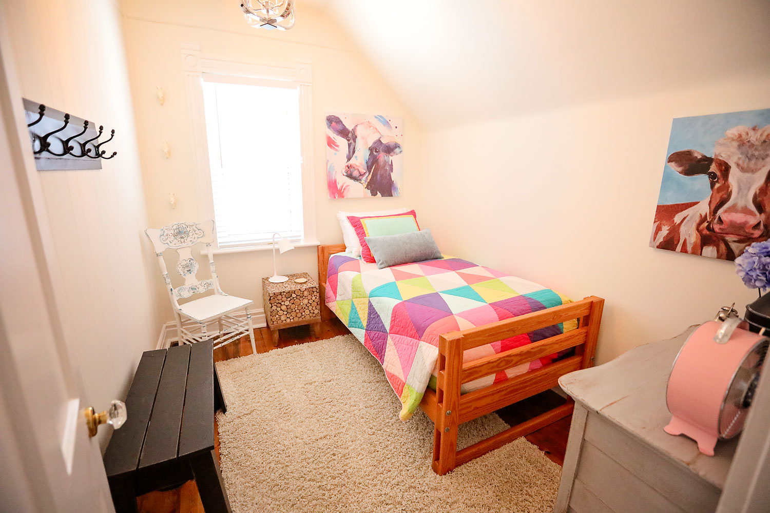 twin bedroom - Enjoy the super comfy bed & adorable decor complete with a bright geometric quilt.