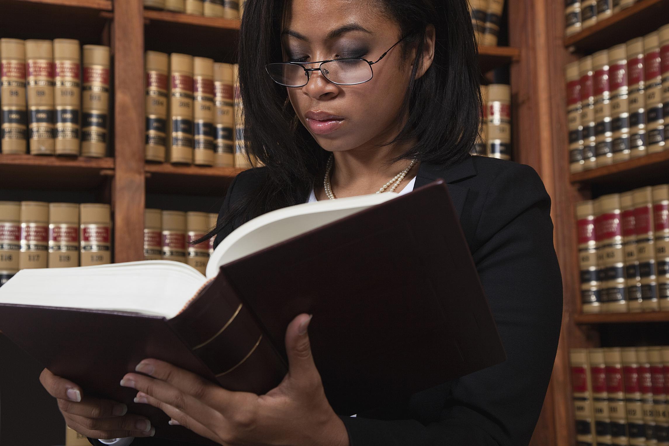 attorney-with-law-books-57a646b53df78cf4591b8b85.jpg