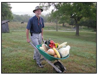 Clyde With Wheelborrow of Garden Groceries.PNG