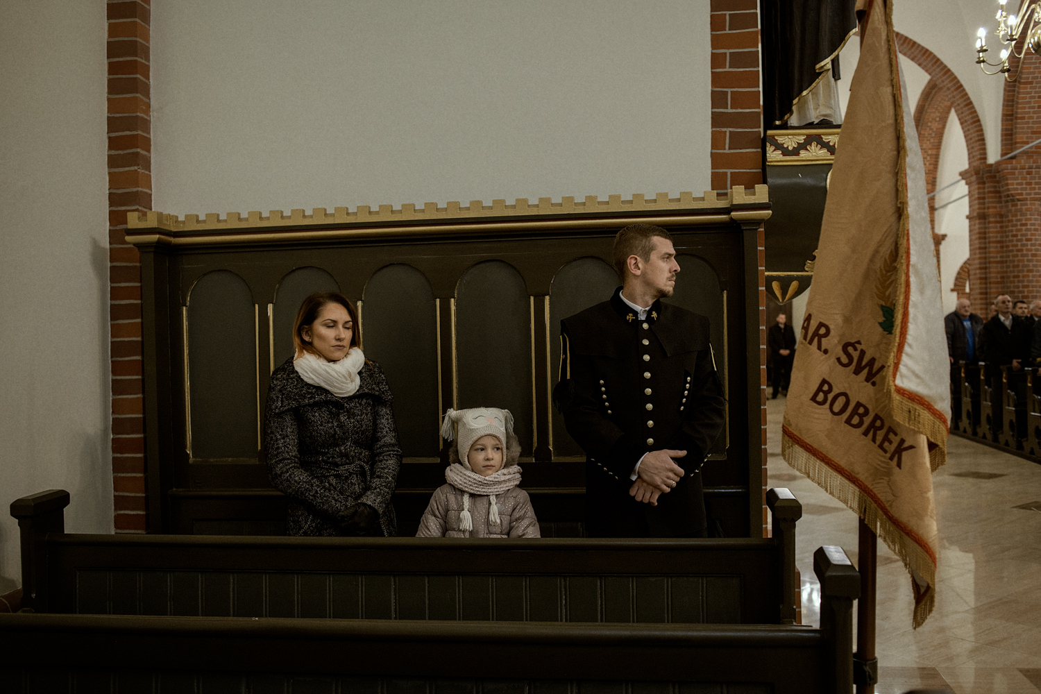 A family celebrates the Mass for Saint Barbara in Bobrek, a neighbourhood in the city of Bytom. Saint Barbara is the coal miner's patron saint.