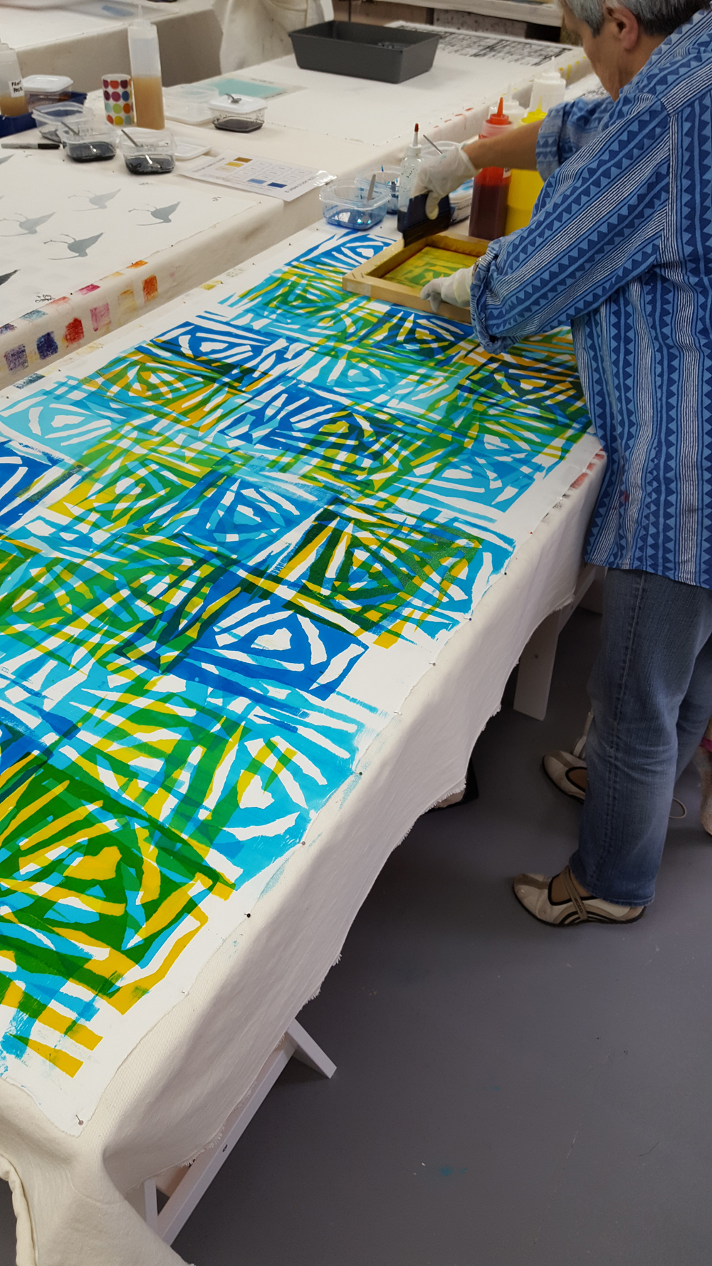 Judy Tomlinson: masking tape resist pulled through with three values of turquoise and yellow giving some lovely greens