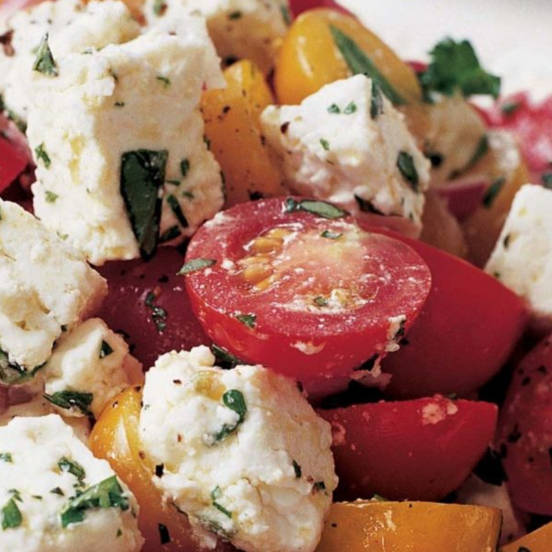 For a beautiful summer picnic staple bursting with umami flavor, try this    Tomato Feta Salad    from the Barefoot Contessa.