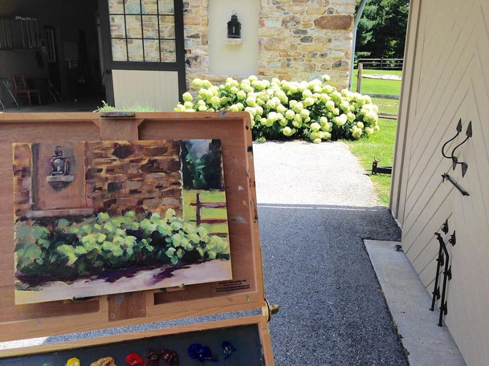 J Bruneau painting stone wall.jpg
