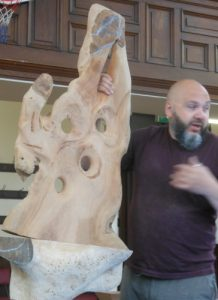 - Discussing the stages of making viewing sculptures for gardens. The piece shown is a Cherry slab sculpture in early stages of carving the design.