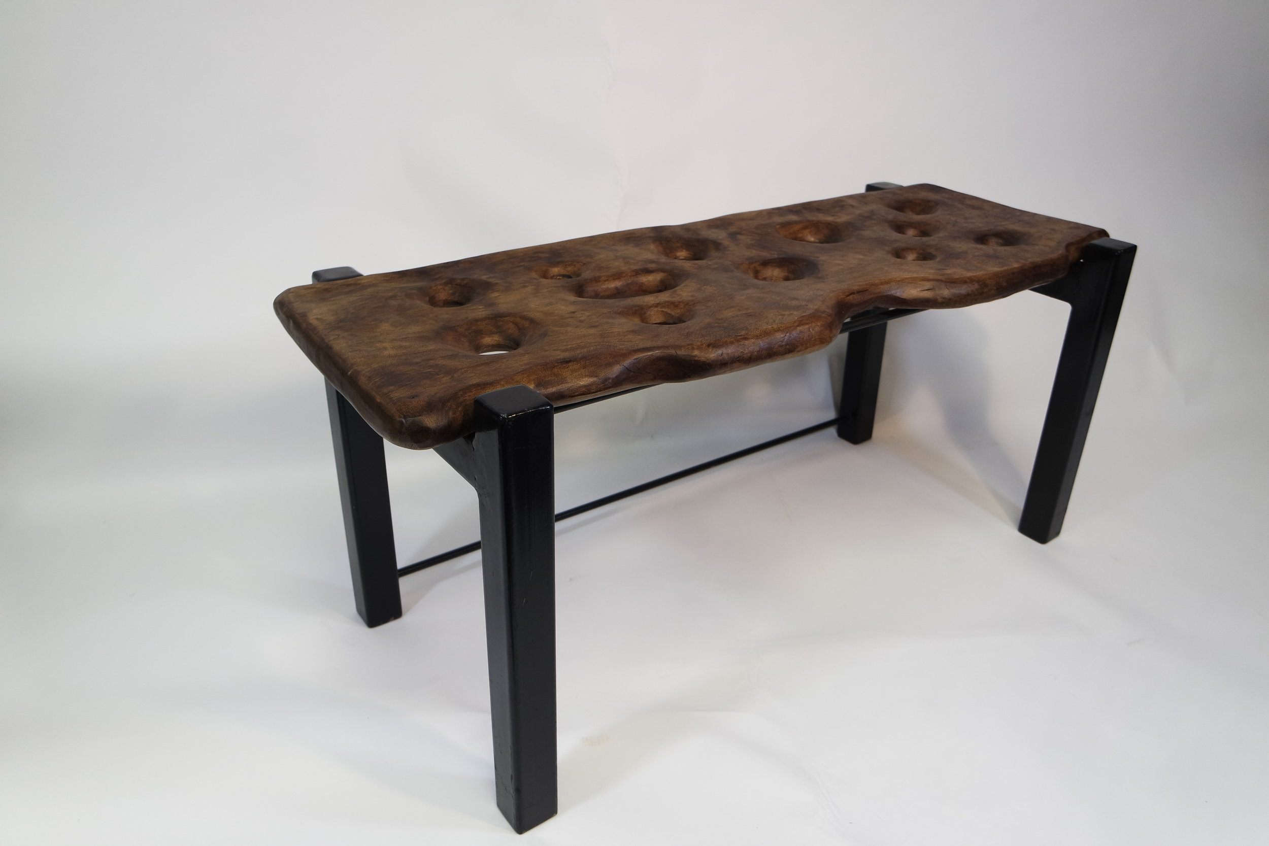 The Holey Bench (Black walnut wood).