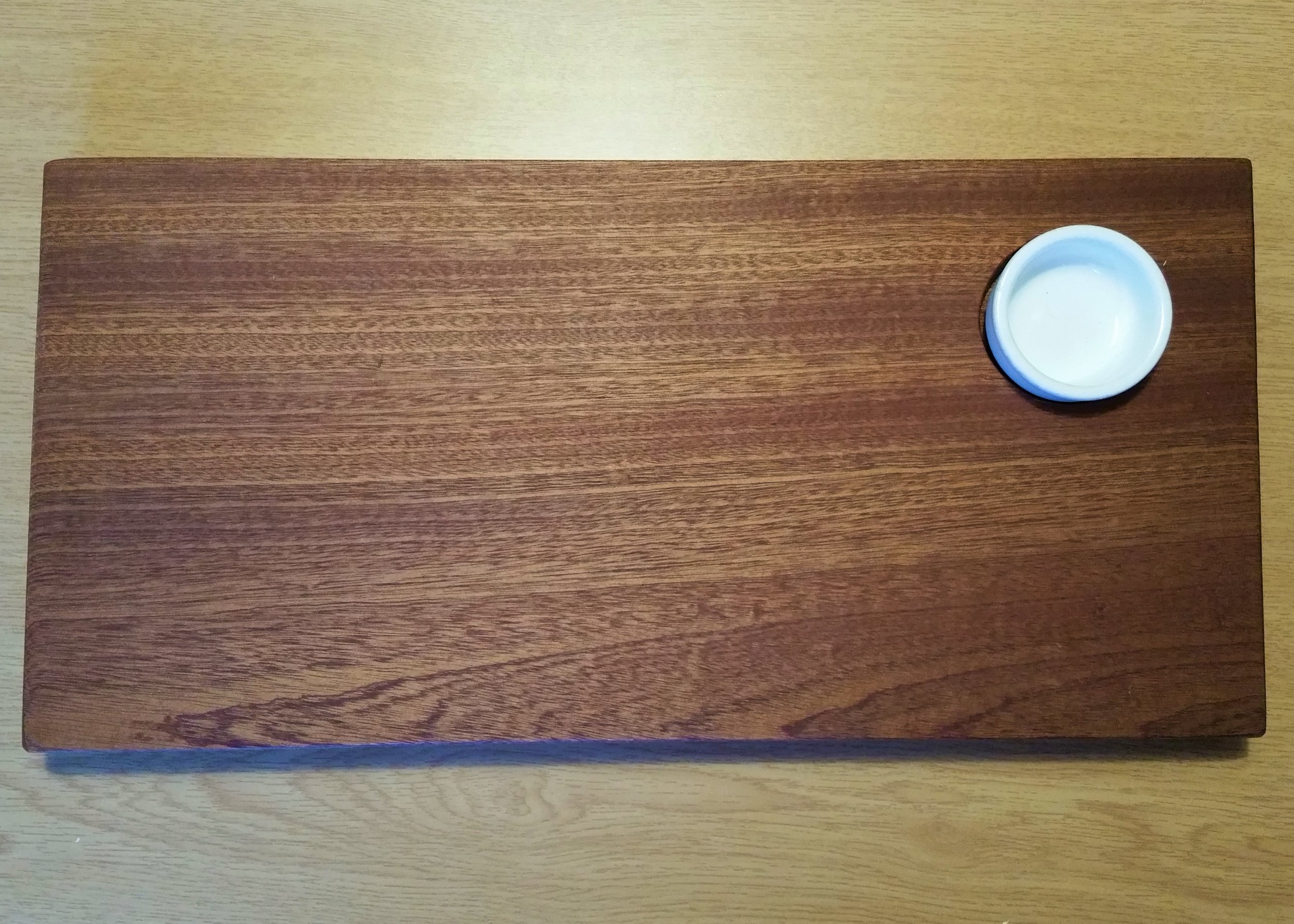 A large Sapele wood Serving platter with Oil bowl.